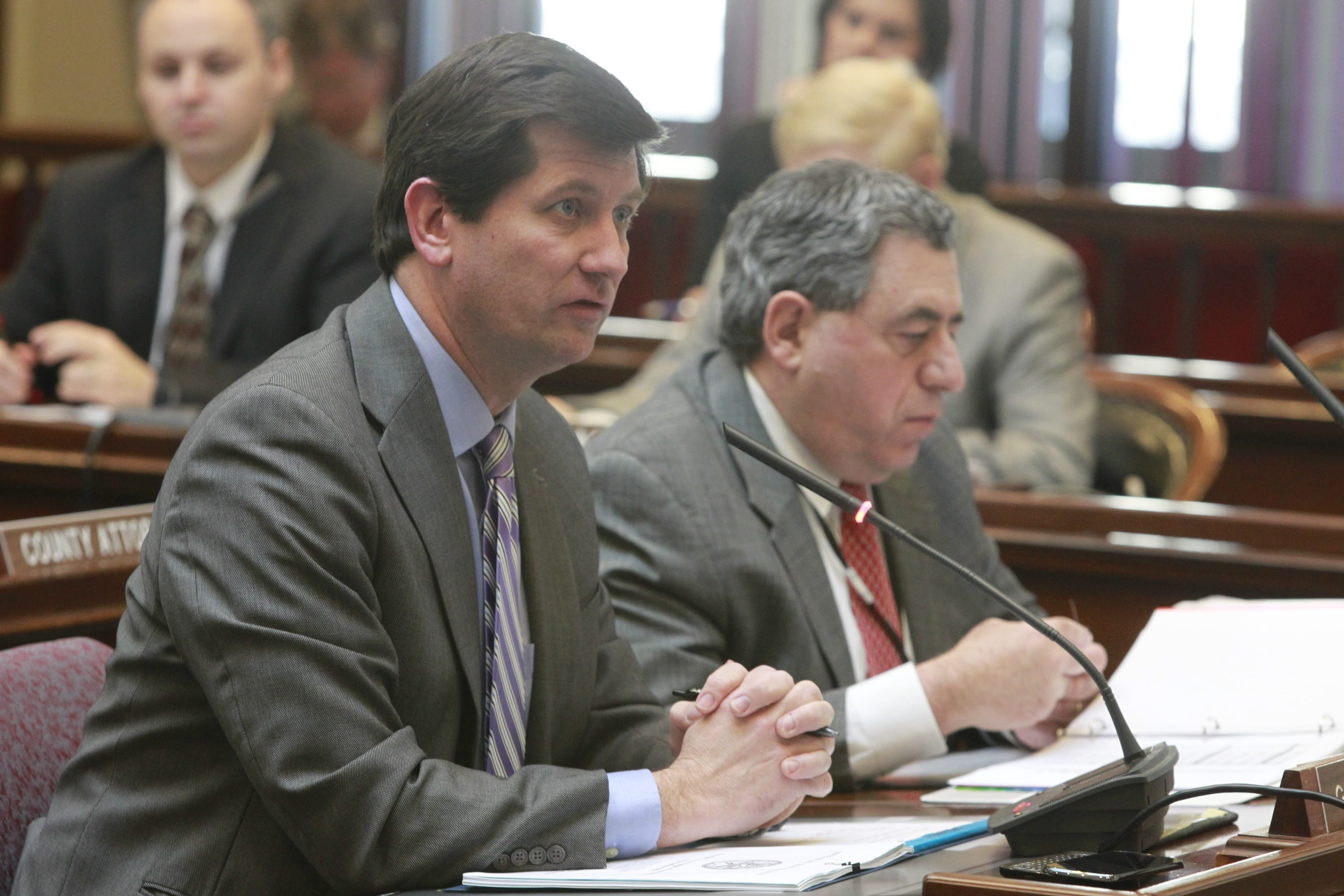 Erie County Executive Mark Poloncarz, left, has a proposal that cites the need to raise taxes or make cuts, or a combination of both. (John Hickey / Buffalo News file photo)