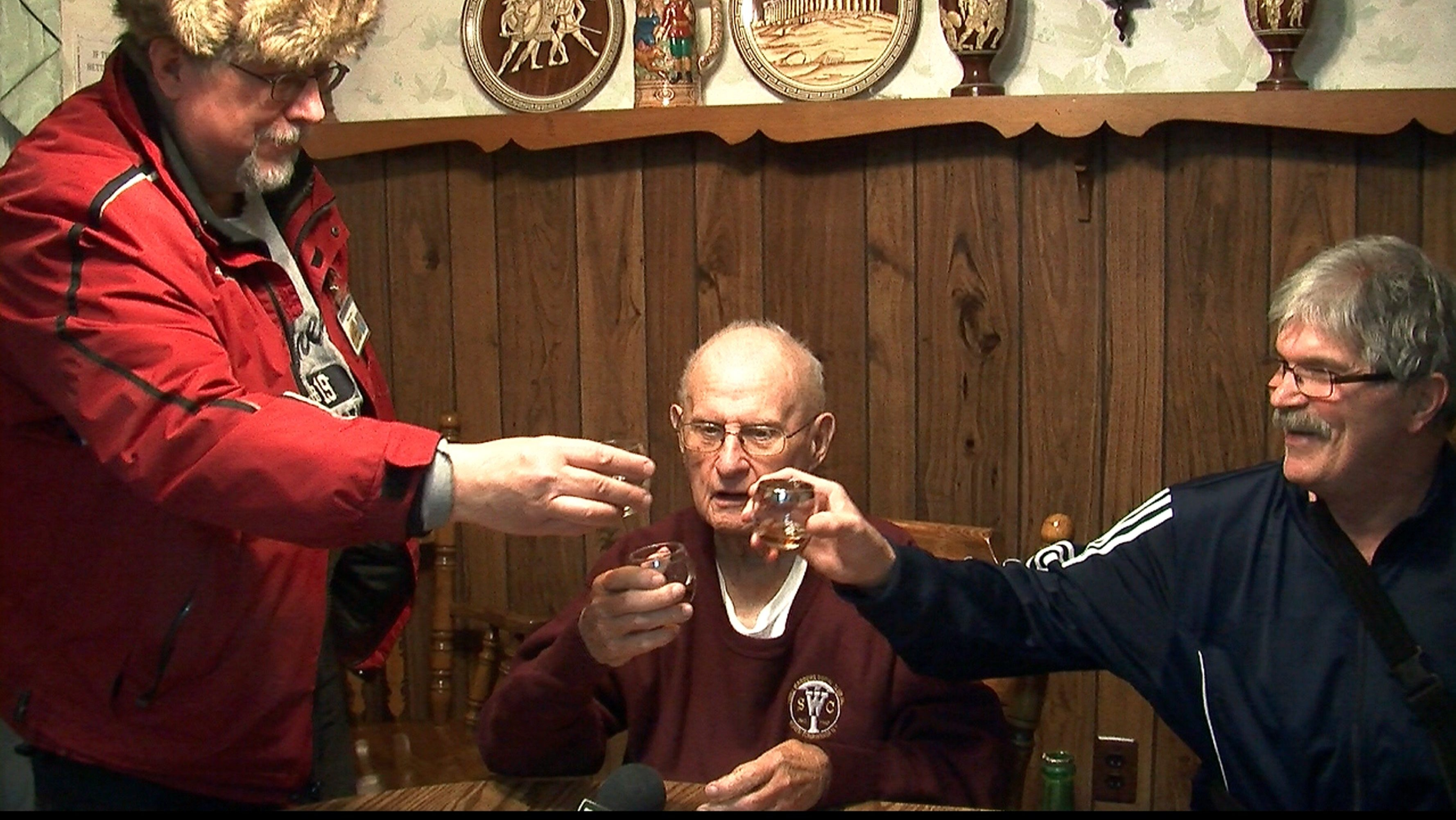 Third Warder Club members Mike Janda, left, and Jim Urbaniak, right, toast Chet Samborski, the last one among 50 friends and club members from 1948.