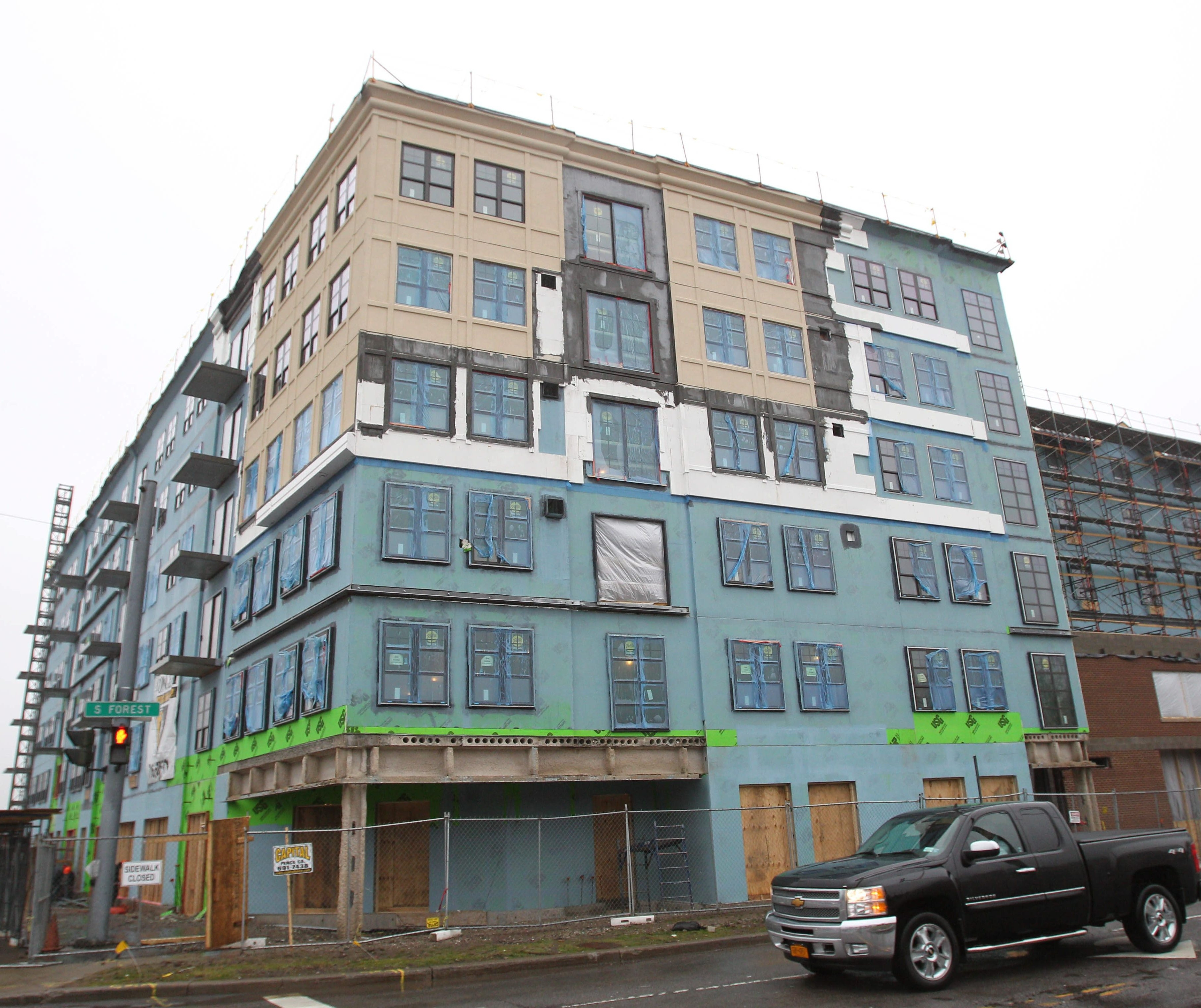"""Ellicott Development's six-story hotel project at the corner of Main Street and South Forest Road has been called """"an architectural travesty"""" by some residents."""