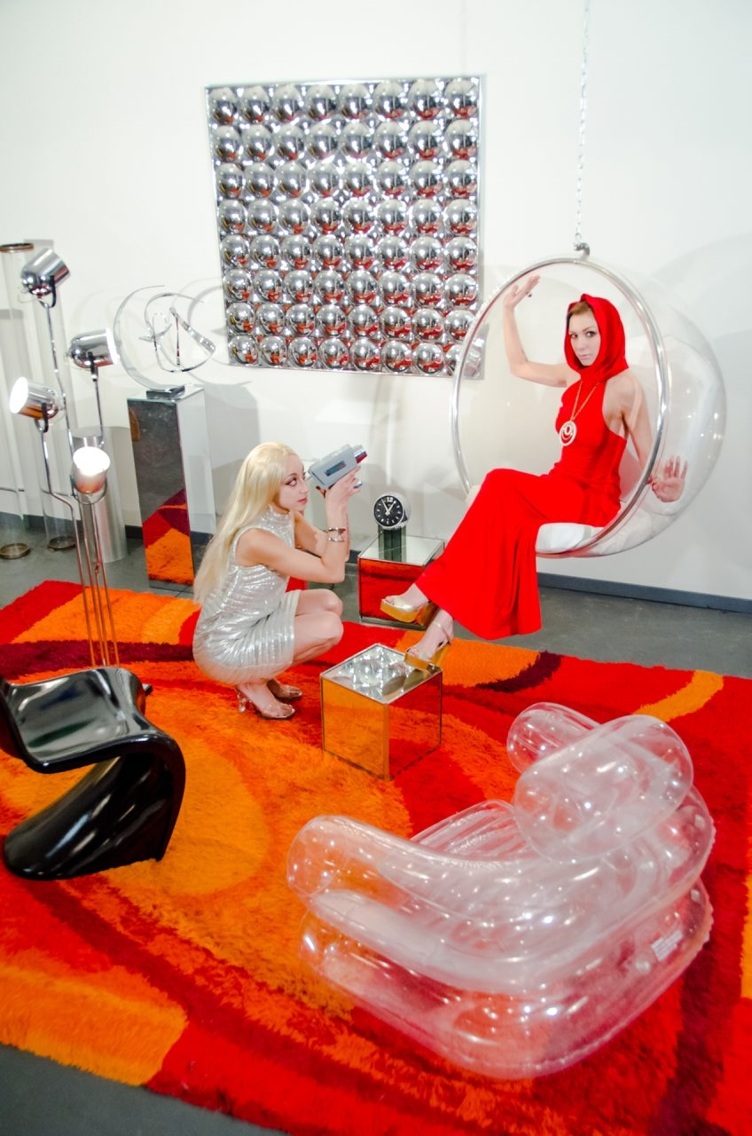 "In this promotional photo for the art exhibition ""The Future Is History,"" models Zuri Appleby and Stephanie Elyse Luksch hang out in the exhibition's '60s-themed room."