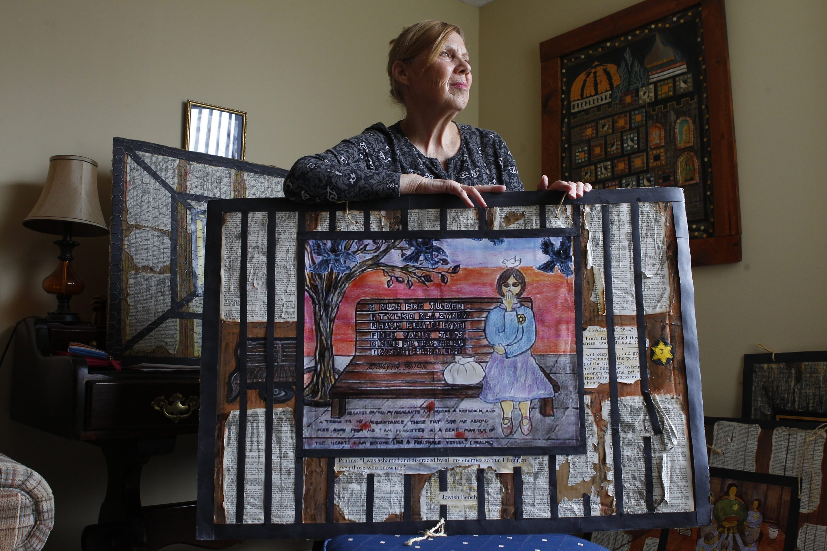 Liat Ben-Shay and one of her paintings, which she creates to help tell the story of the horrors of the  Holocaust.