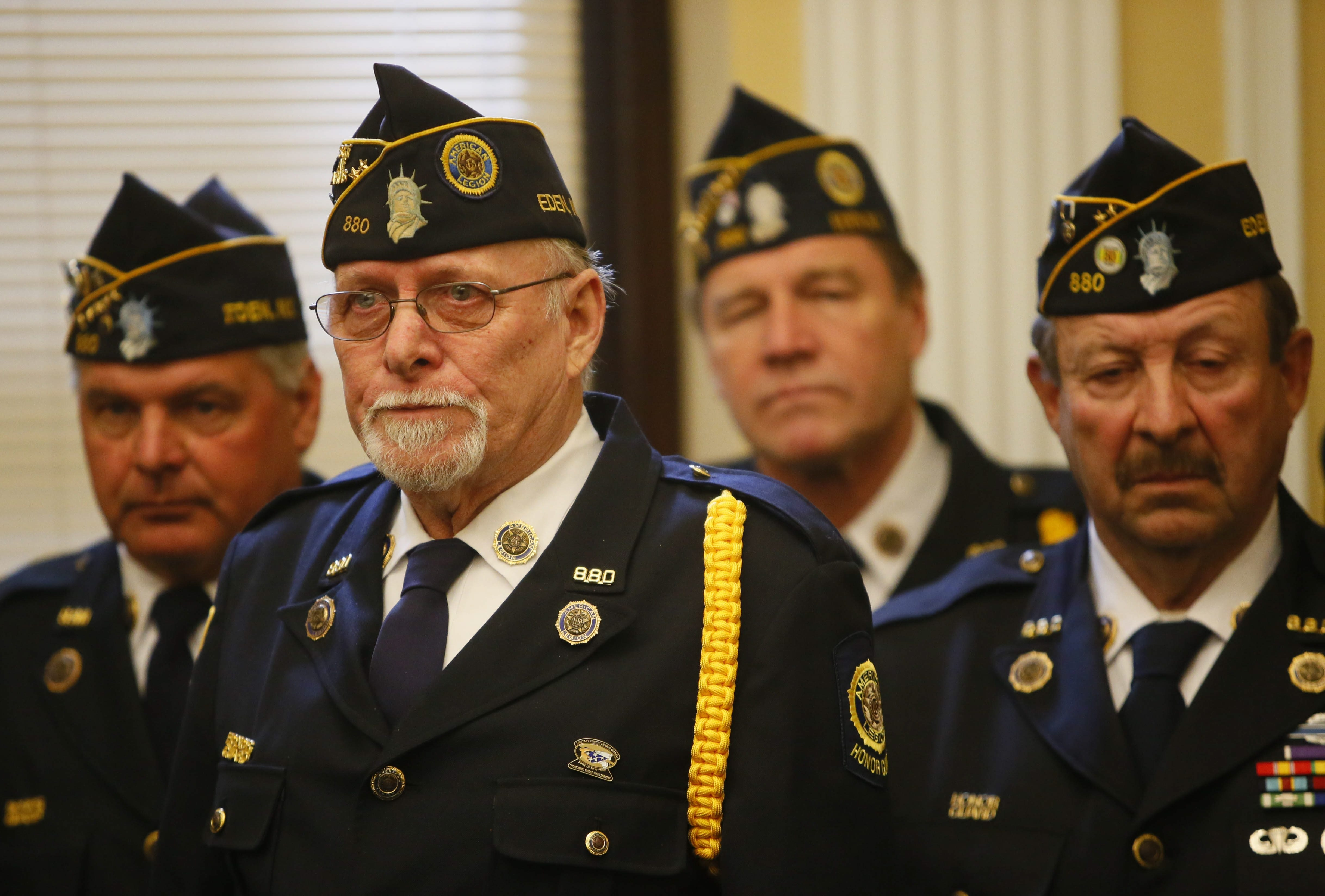 Forty-seven years after receiving wounds that earned him a second Purple Heart for Vietnam combat, Robert Franz, foreground, is joined by his American Legion buddies during the Erie County Hall ceremony to award him the medal.