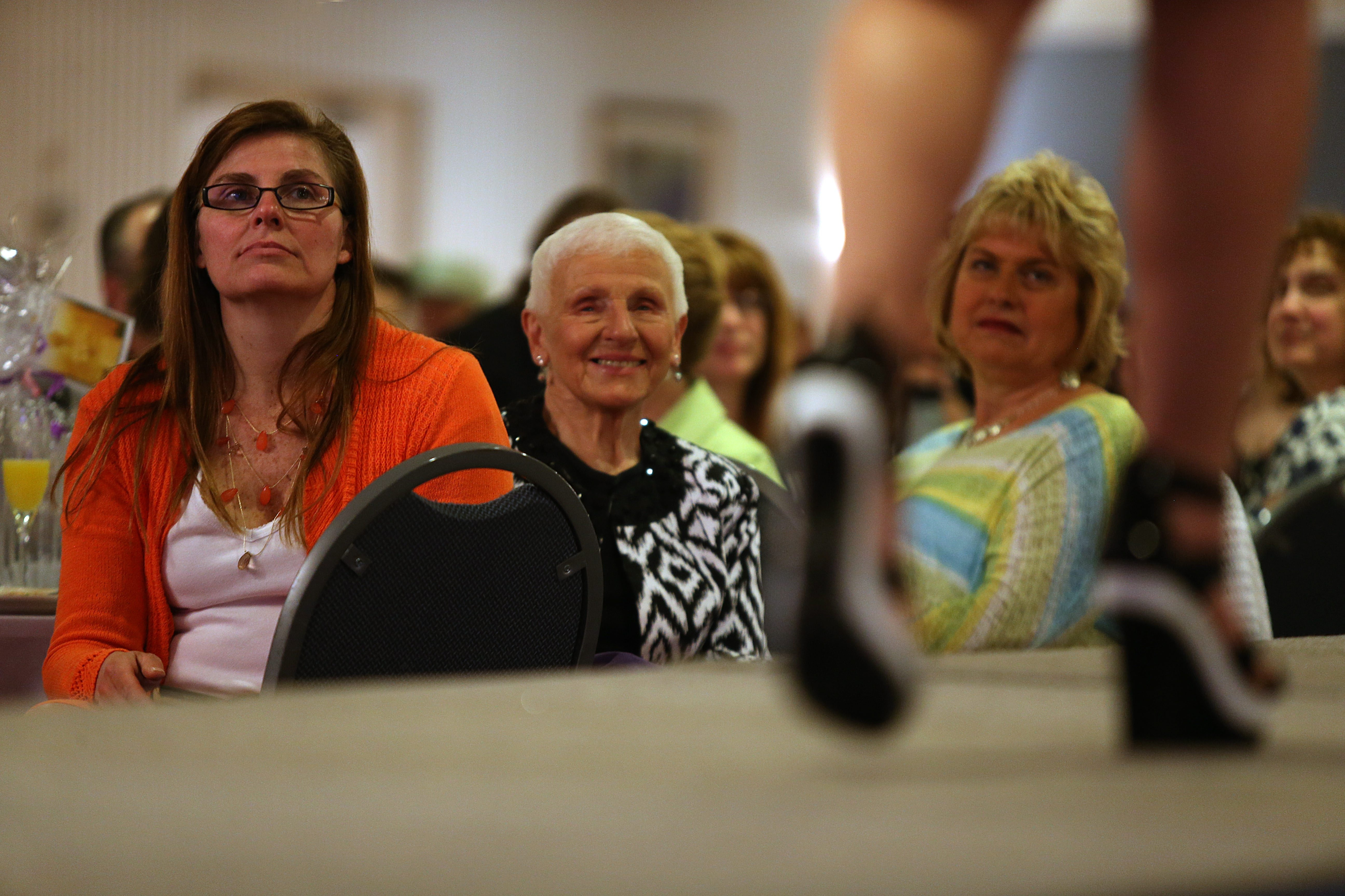 Left to right, Jackie Yager, of Silver Creek, June Kij, of Lackawanna, and Sheree Belle, of Williamsville, watch models on the runway at Hearthstone Manor during a fashion show to benefit Haven House.