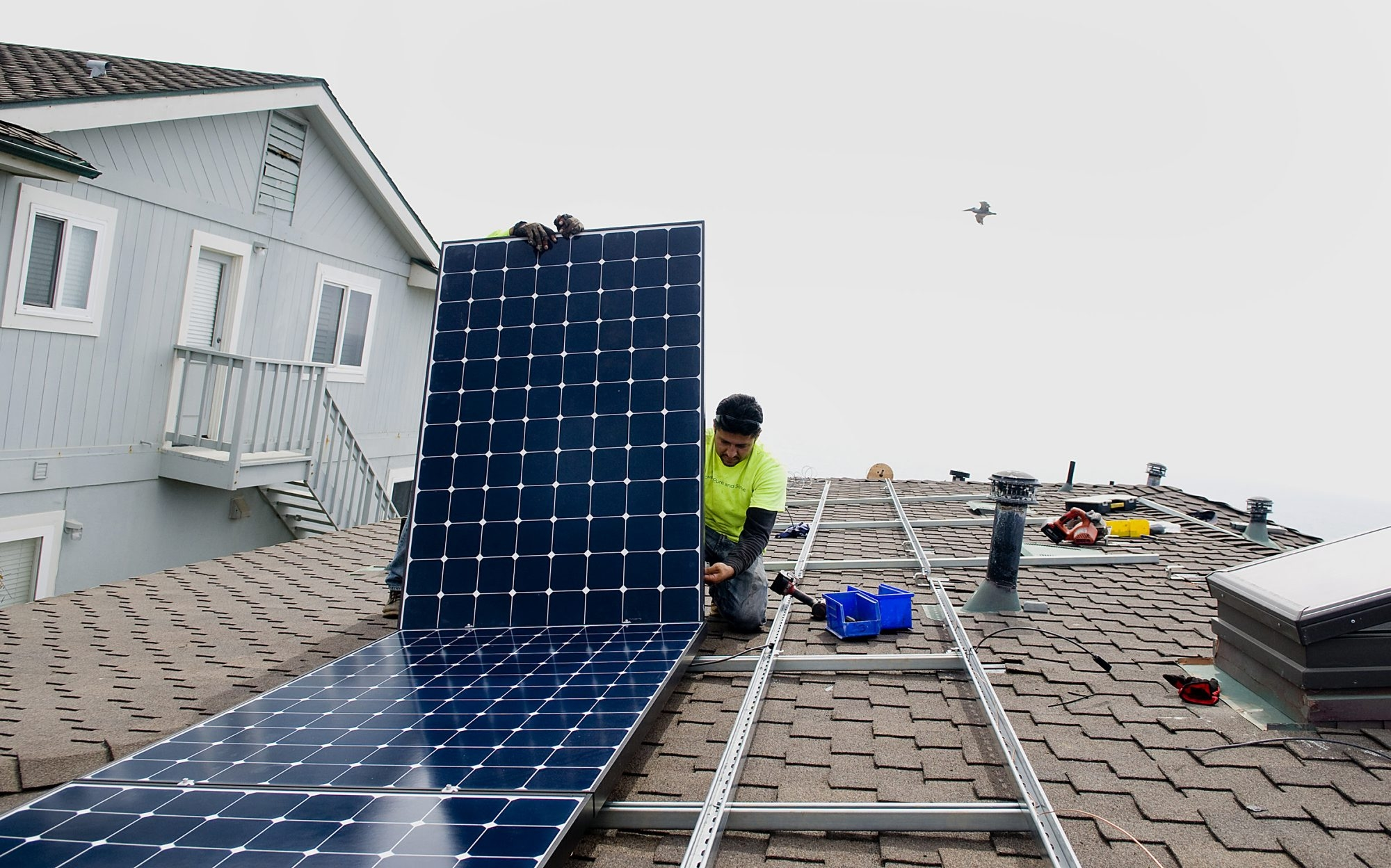 Stellar Solar installer Juan Moedano positions a solar panel during installation at a home in Encinitas, Calif. Shopping for solar power systems can be a daunting task for consumers.