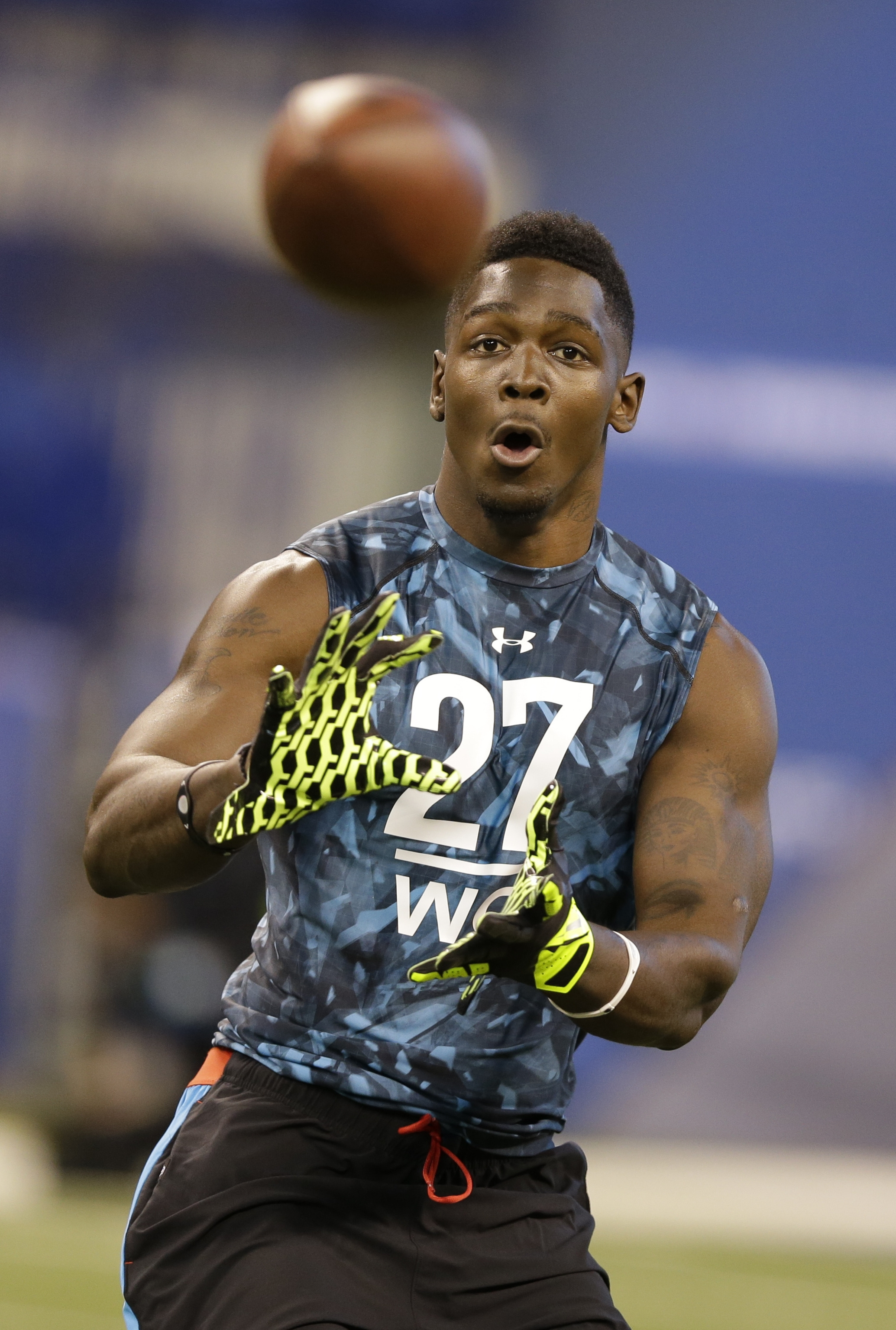 This February file photo shows Tennessee Tech receiver Da'Rick Rogers running a drill at the NFL football scouting combine in Indianapolis. (AP Photo/Michael Conroy, File)