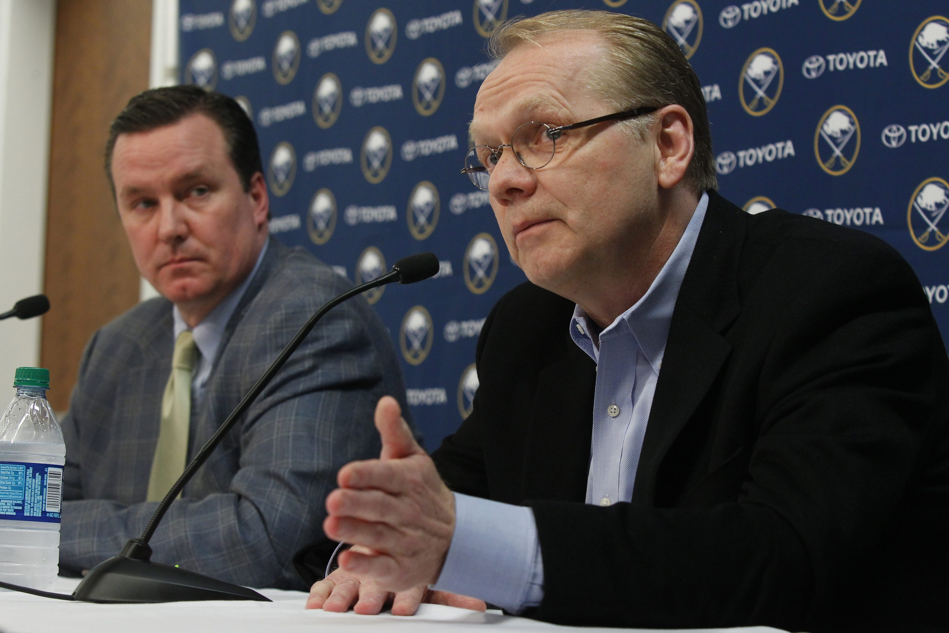 Buffalo Sabres President Ted Black, left, and general manager Darcy Regier talked about various aspects of the team's future at the end-of-season news conference in First Niagara Center on Monday. (Harry Scull Jr./Buffalo News)