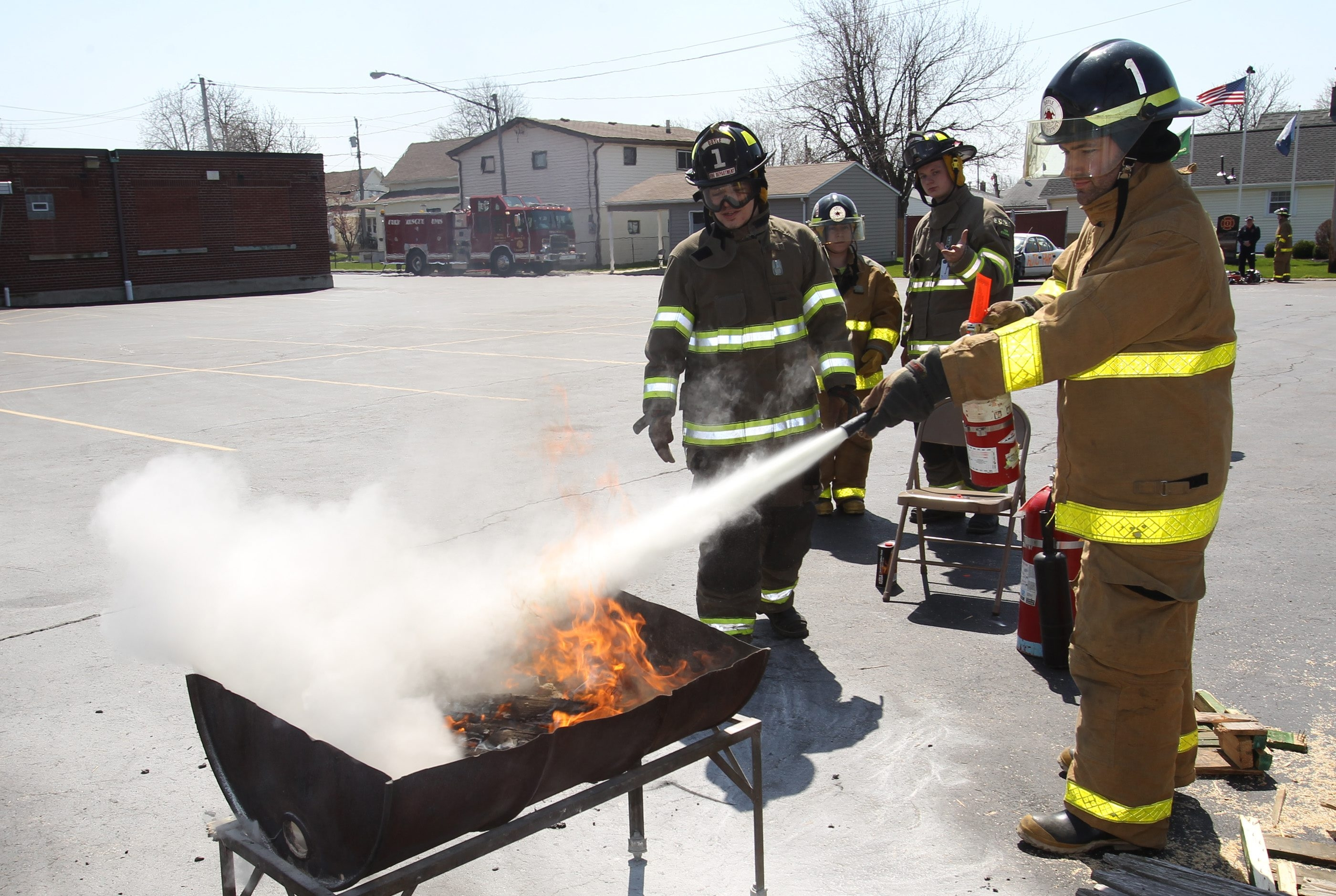 Joe and Teresa Tasker, of Cheektowaga, learn how to put out a fire using a fire extinguisher during an open house Saturday at Doyle Hose Co. 1 on William Street in Cheektowaga.