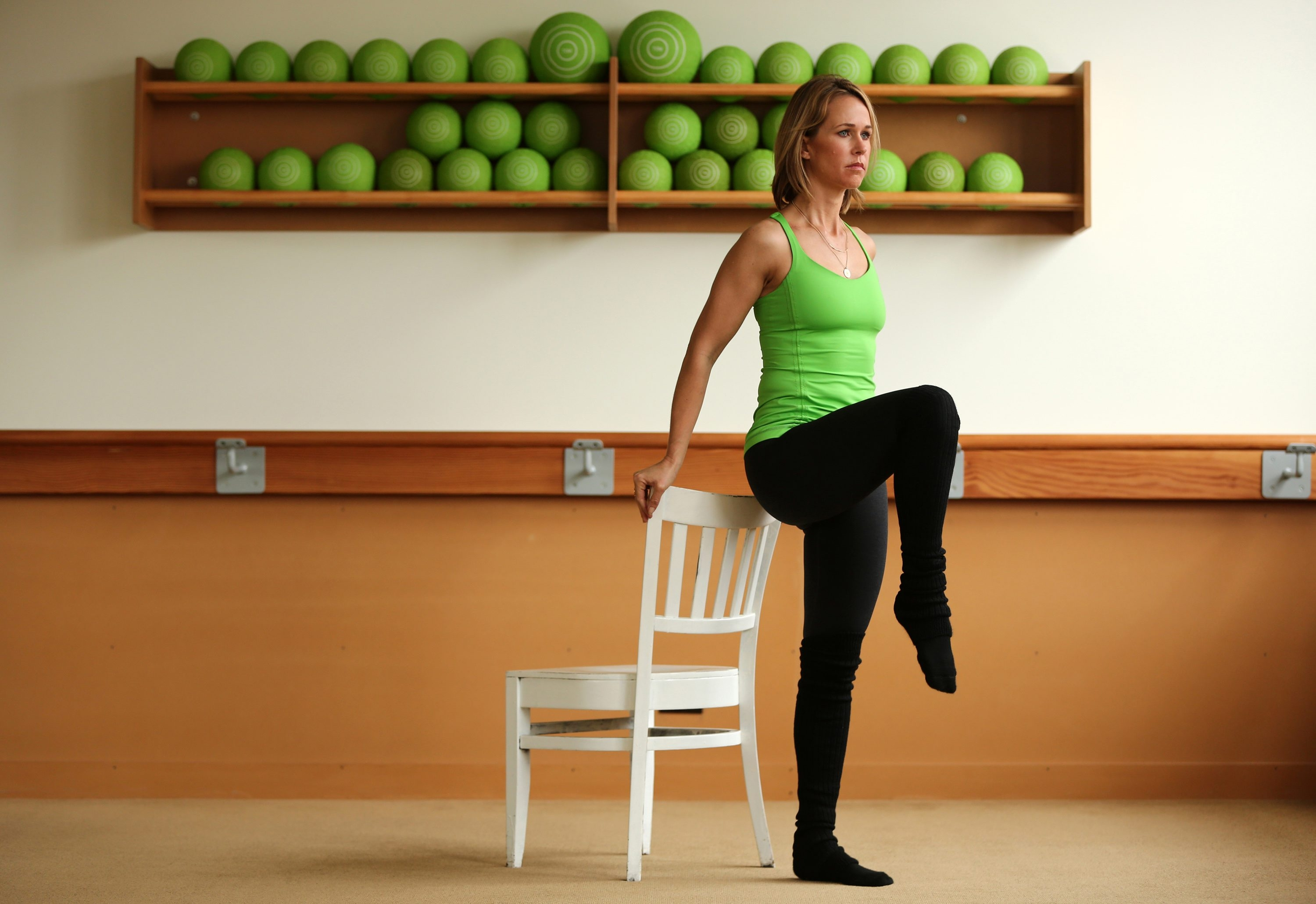 Jill Dailey McIntosh, founder of the Dailey Method barre workouts, demonstrates leg lifts.