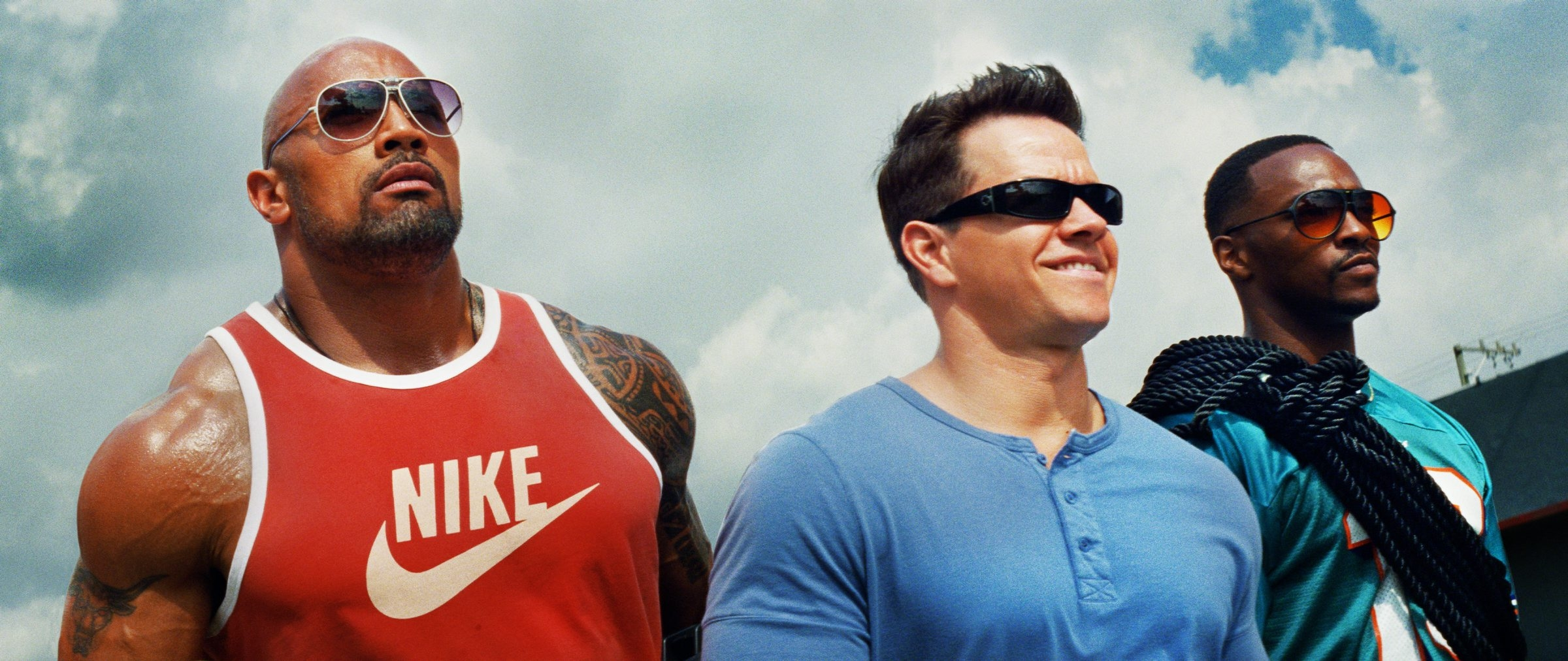 (Left to right) Dwayne Johnson as Paul Doyle, Mark Wahlberg as Daniel Lugo and Anthony Mackie as Adrian Doorbal in PAIN AND GAIN, directed by Michael Bay from Paramount Pictures.