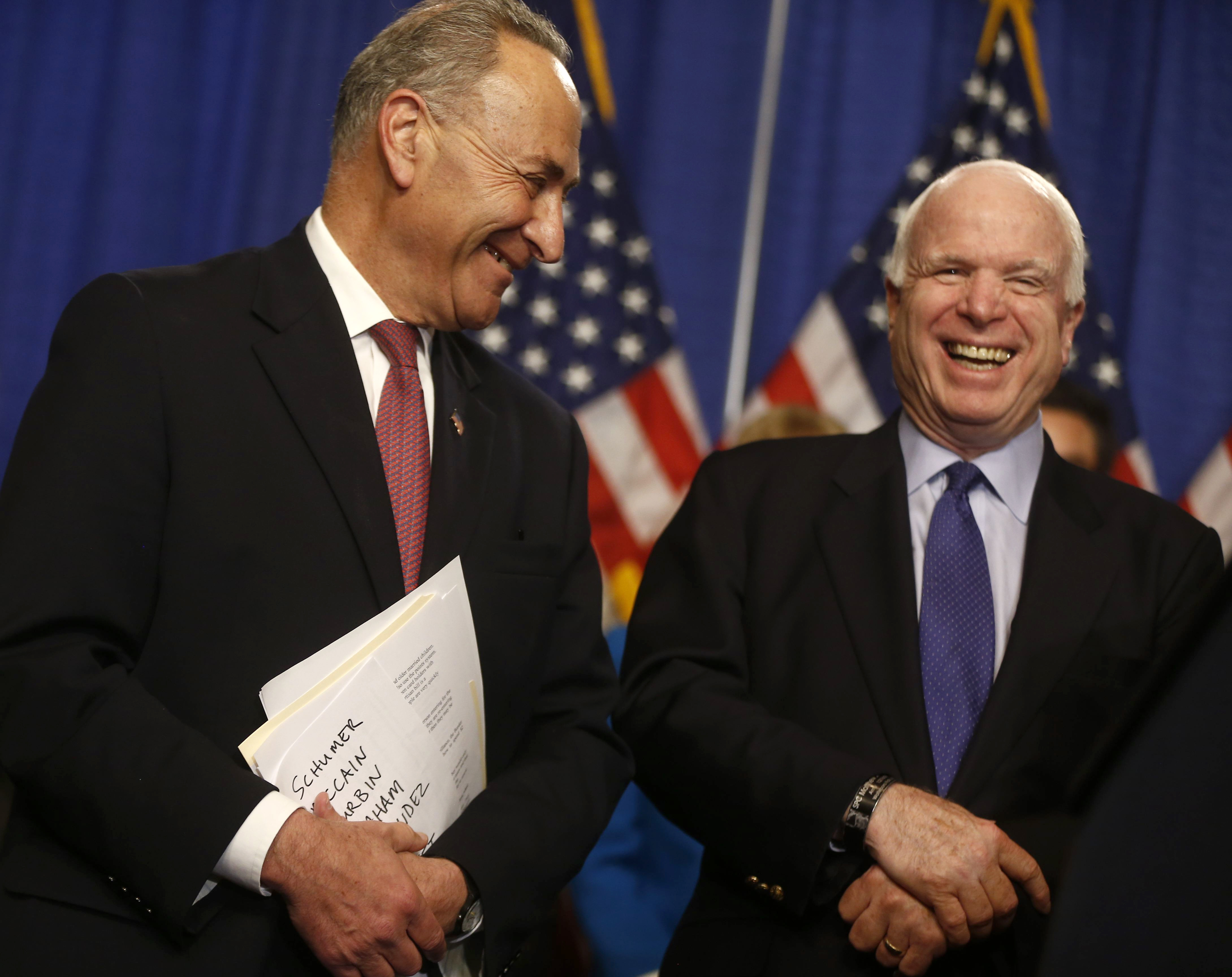Sens. Charles E. Schumer, left, and John McCain have overcome their long-standing partisan rivalry and now speak highly of each other's efforts to come up with an immigration bill that has a chance to pass in the Senate.