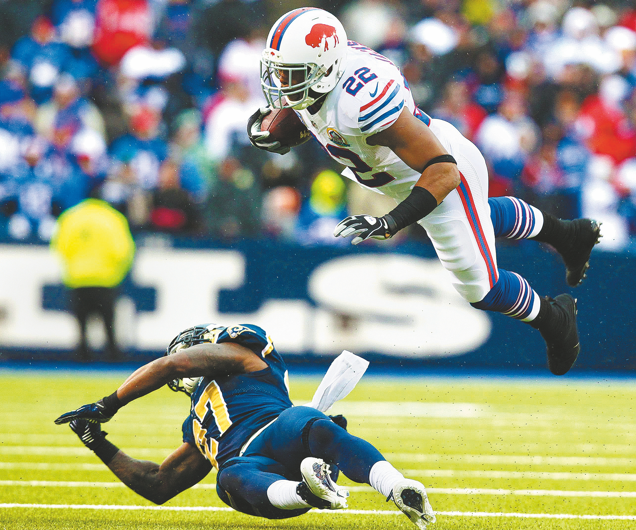 Buffalo Bills running back Fred Jackson (22) dives over St. Louis Rams free safety Quintin Mikell (27) in the third quarter at Ralph Wilson Stadium on Sunday, Dec. 9, 2012.  (James P. McCoy / Buffalo News)