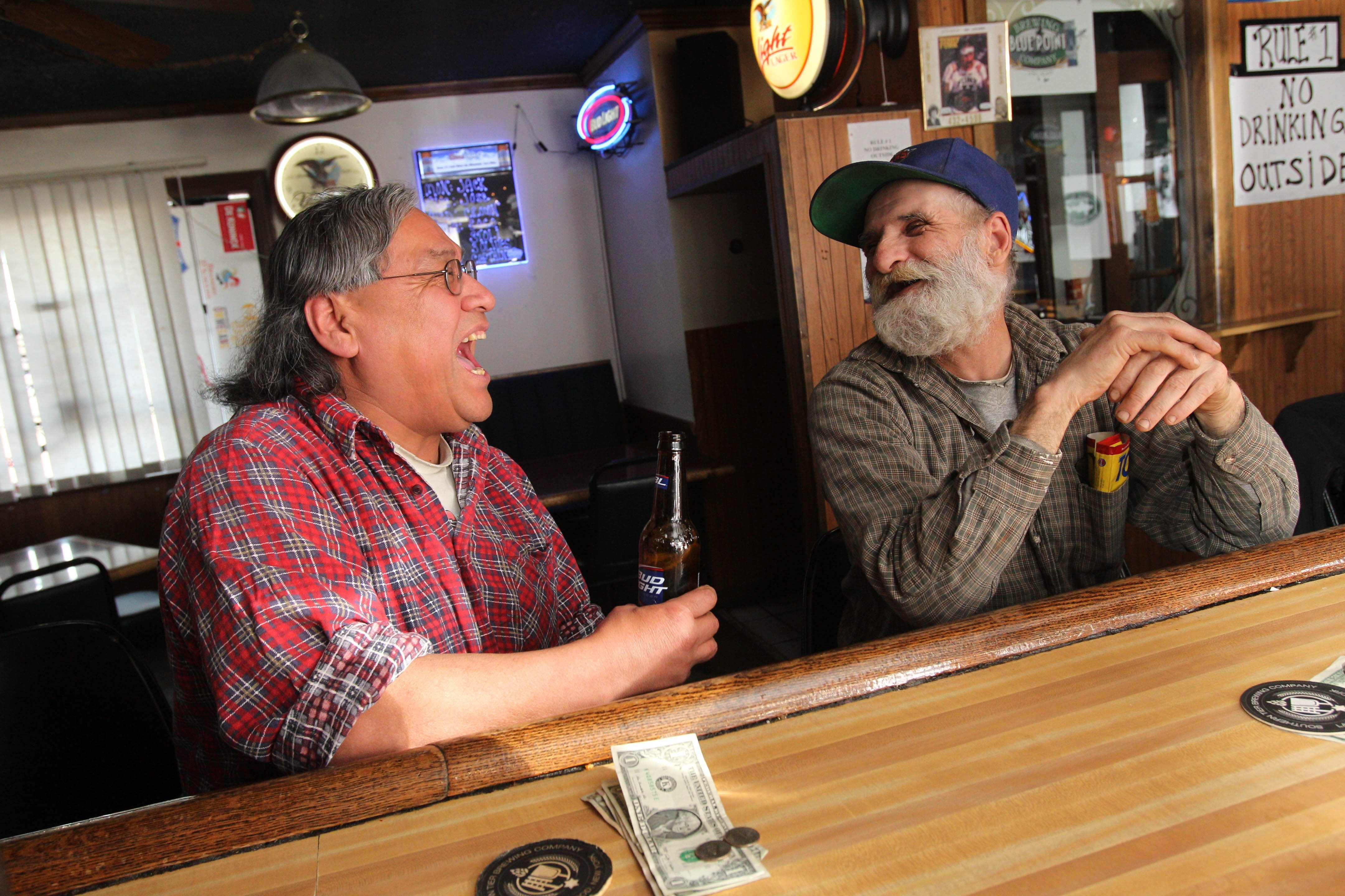 Mery Jacobs, left, and Ed Tuttle, both of Cheektowaga, share a few laughs at Crabapples Micro Brew Pub, where there are 38 rotating taps.
