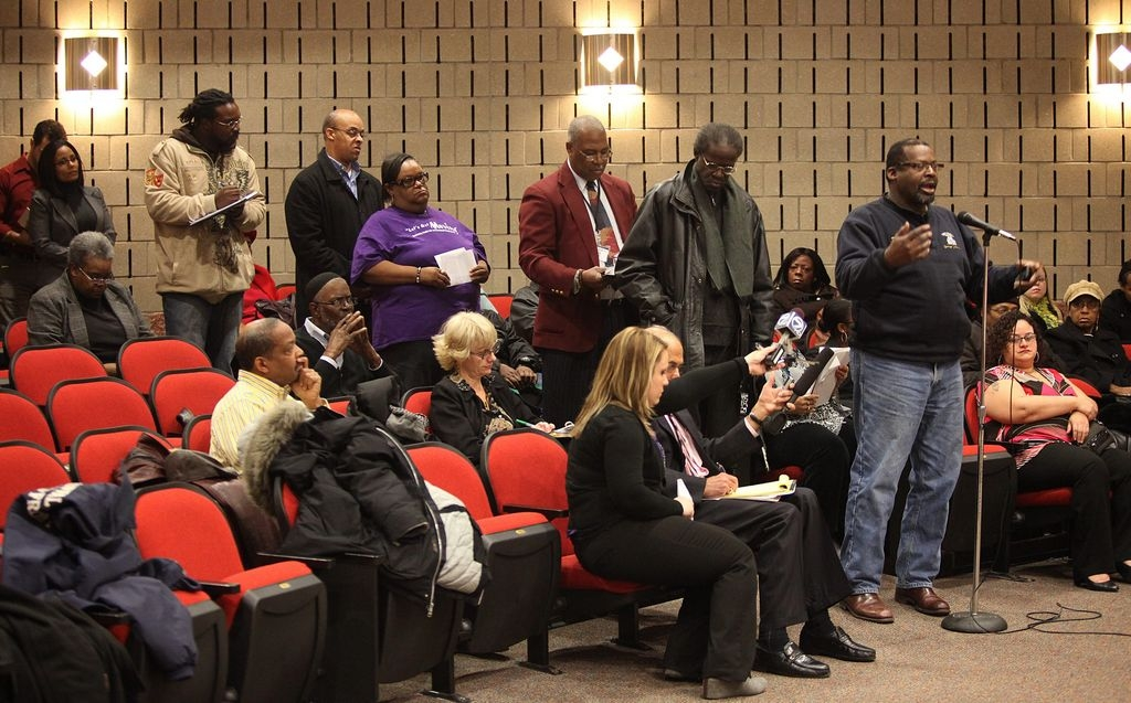 This file photo shows a line of people waiting to speak at an advisory board hearing on school suspensions in the Buffalo Public Schools at Merriweather Library in Buffalo, Jan. 2012.