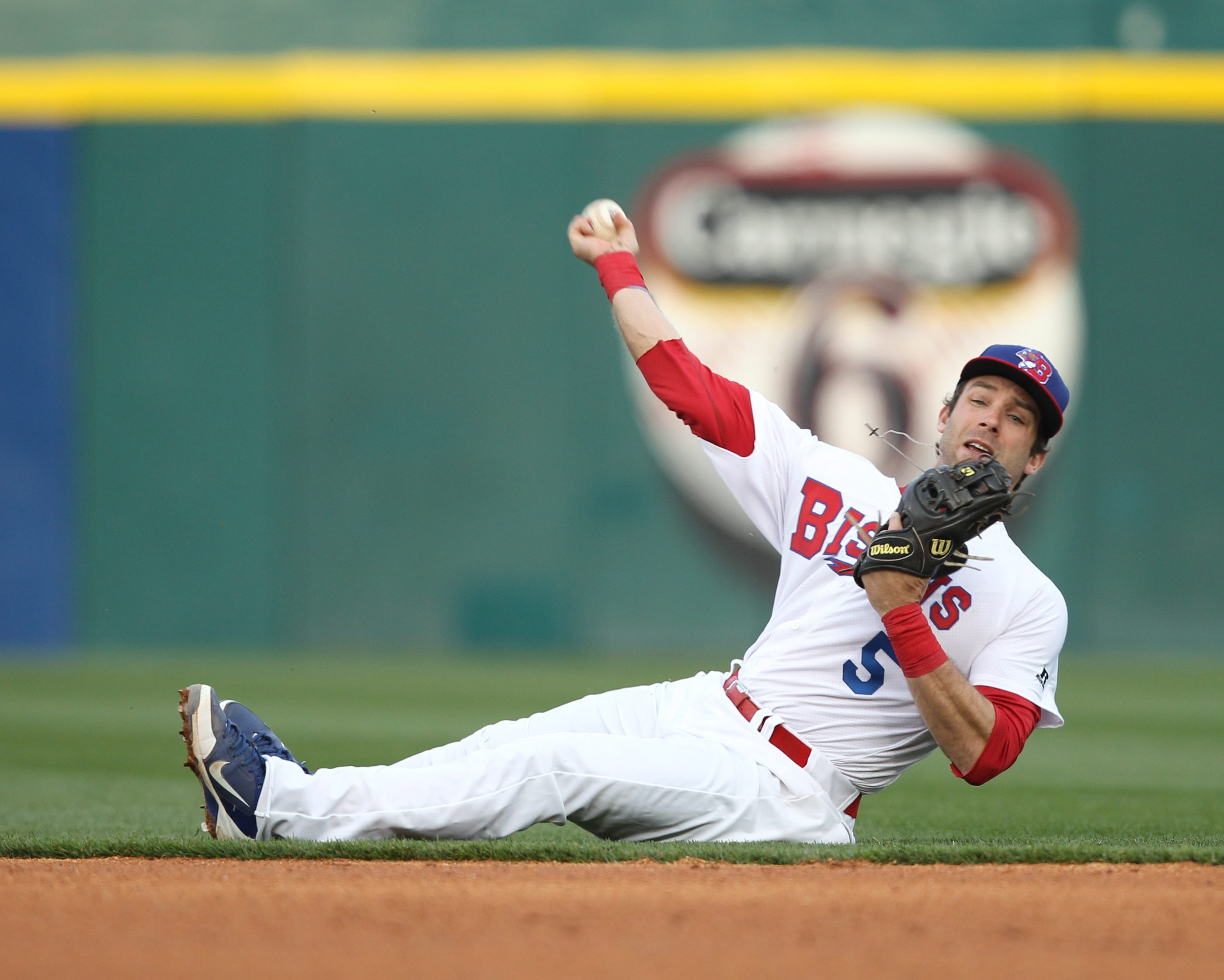 Bisons second baseman Jim Negrych makes a diving stop.