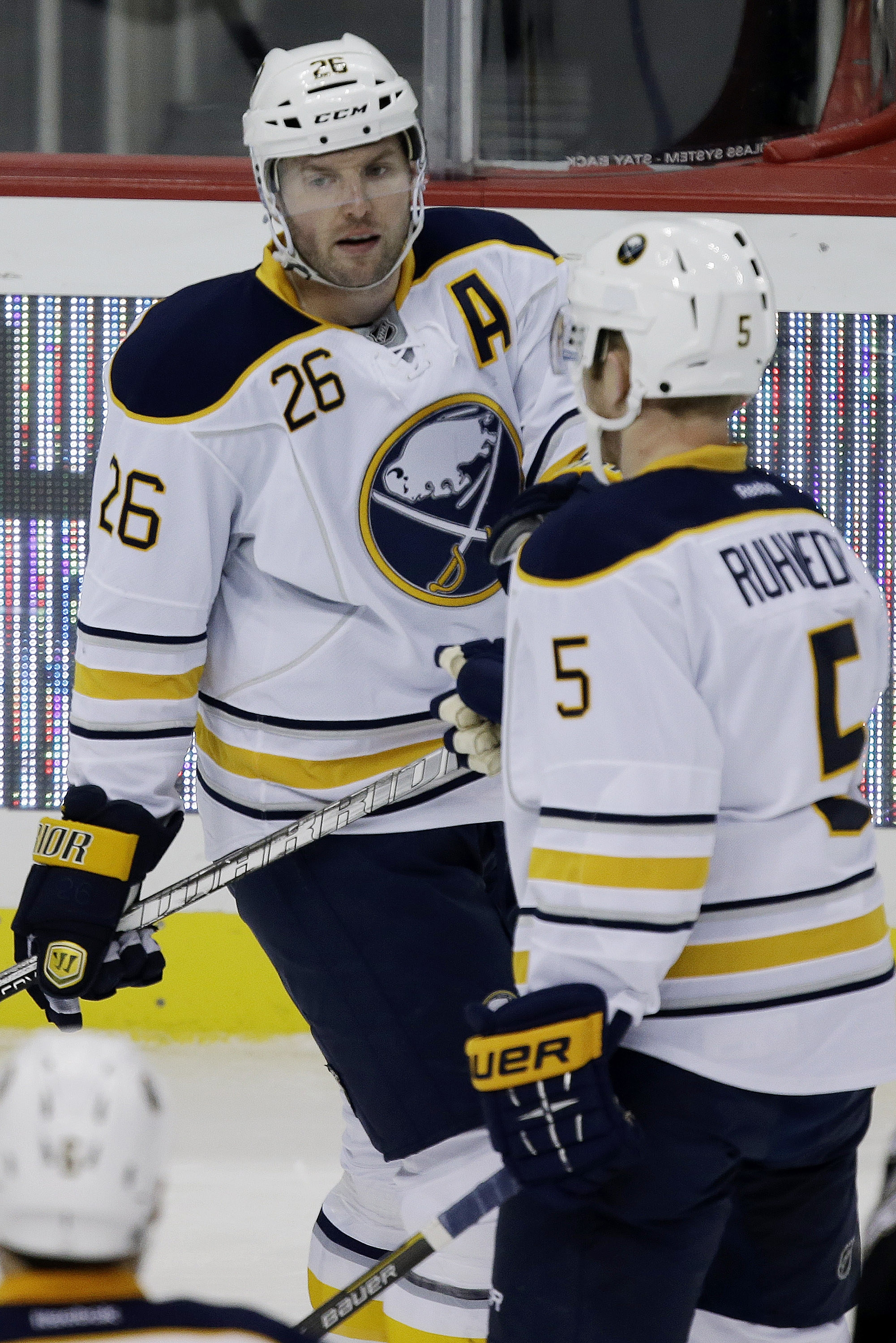 Buffalo's Thomas Vanek (26) celebrates his first goal of the game with teammate Chad Ruhwedel during a 4-2 victory.