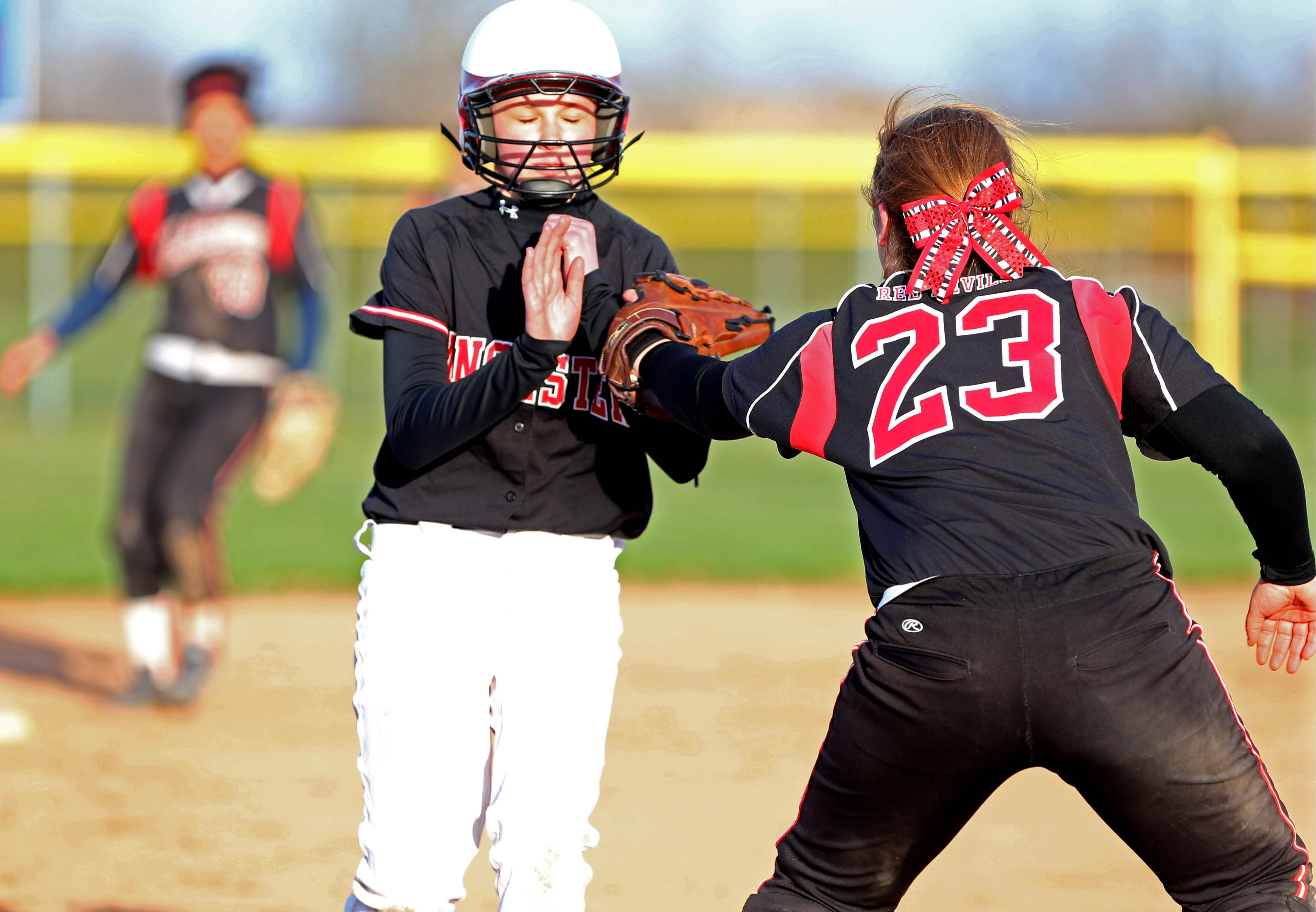 """Clarence third baseman Moriah Harris tags out Lancaster's Chelsea Davis during the finals of the Fort Myers bracket at Sunday's inaugural Gerry Gentner """"Just Show Up"""" Memorial Softball Tournament, at the Northtown Center at Amherst."""
