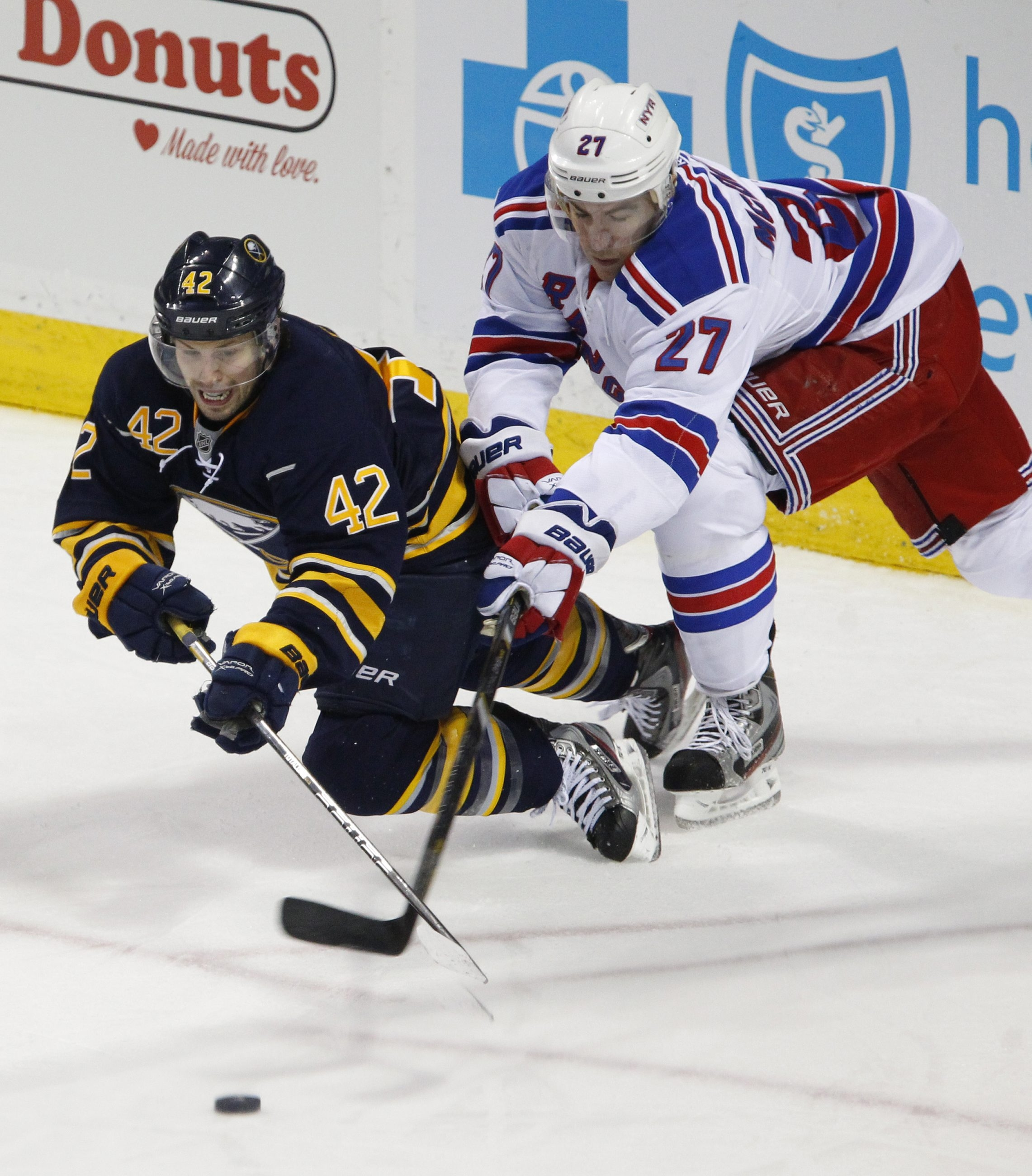 Nathan Gerbe (42) and the Sabres' loss to Ryan McDonagh and the Rangers on Friday means Buffalo has missed the playoffs four times in six years.