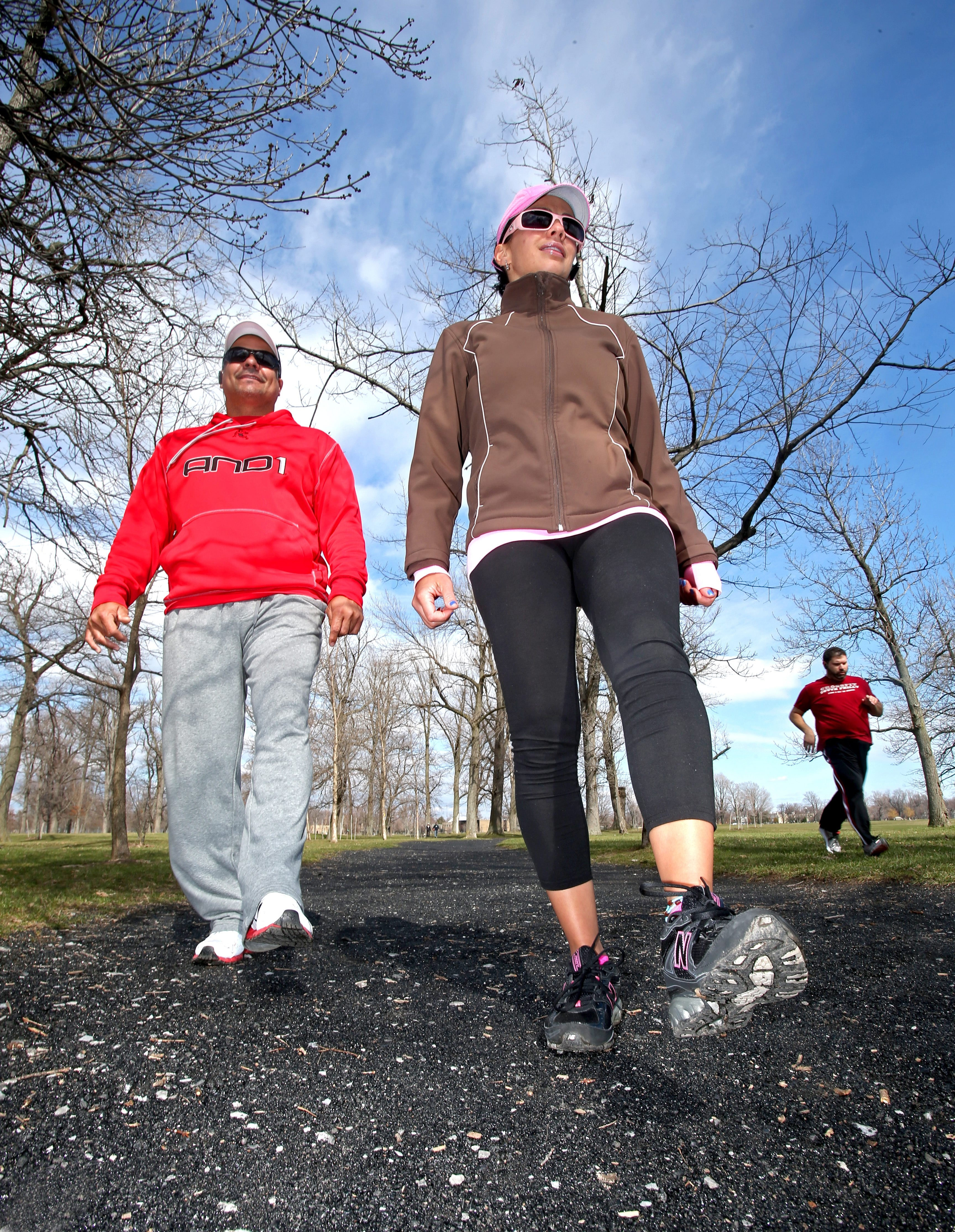 Frequent fitness walkers Ness Gonzalez, left, and Liz Cruz try to walk daily at Delaware Park in Buffalo.