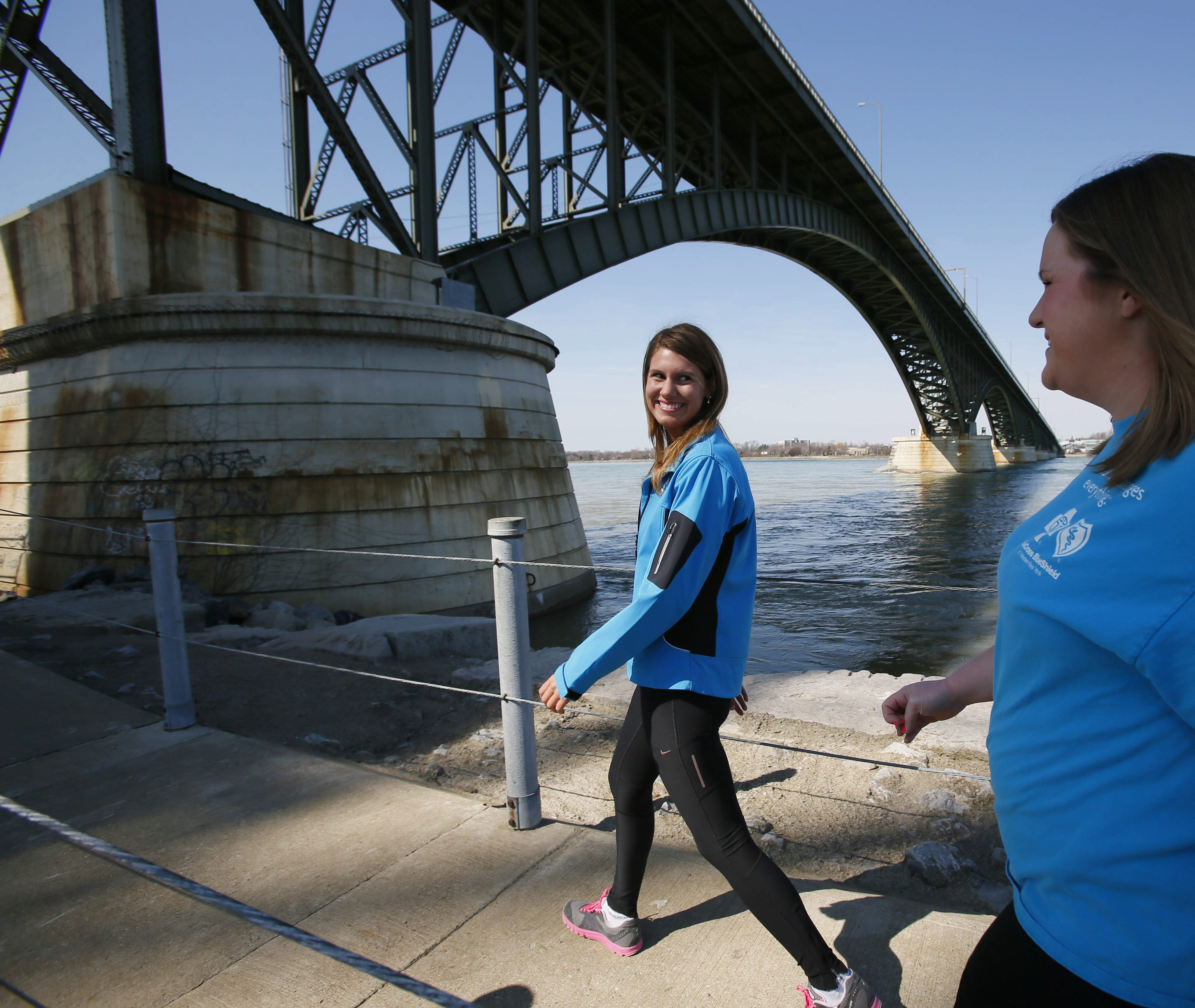 Moira Giammaresi, left, and Caroline Hurley, co-workers at BlueCross BlueShield, walk along Bird Island Pier.