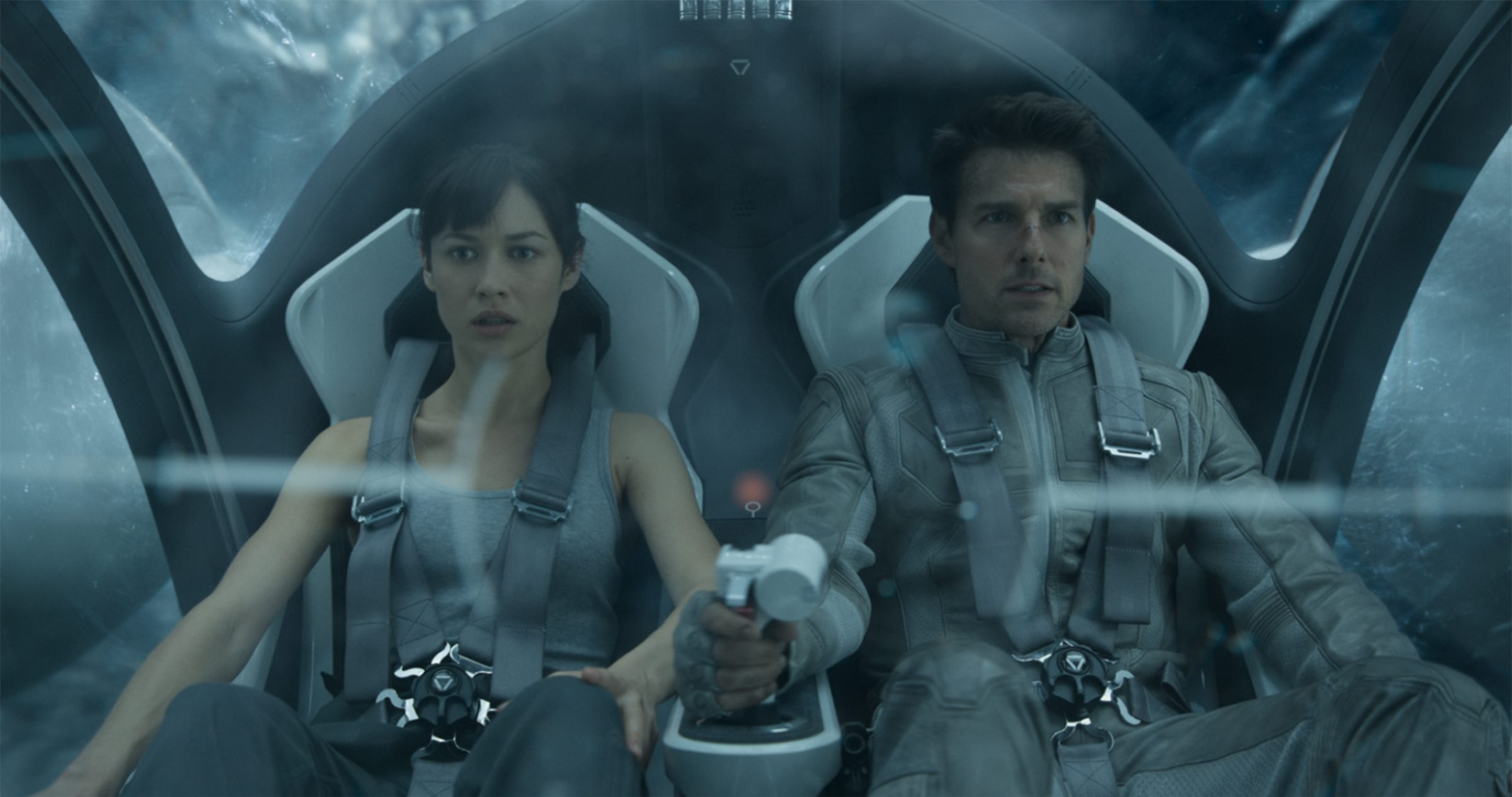 "Olga Kurylenko and Tom Cruise hurtle through the air in the Bubbleship in ""Oblivion."""