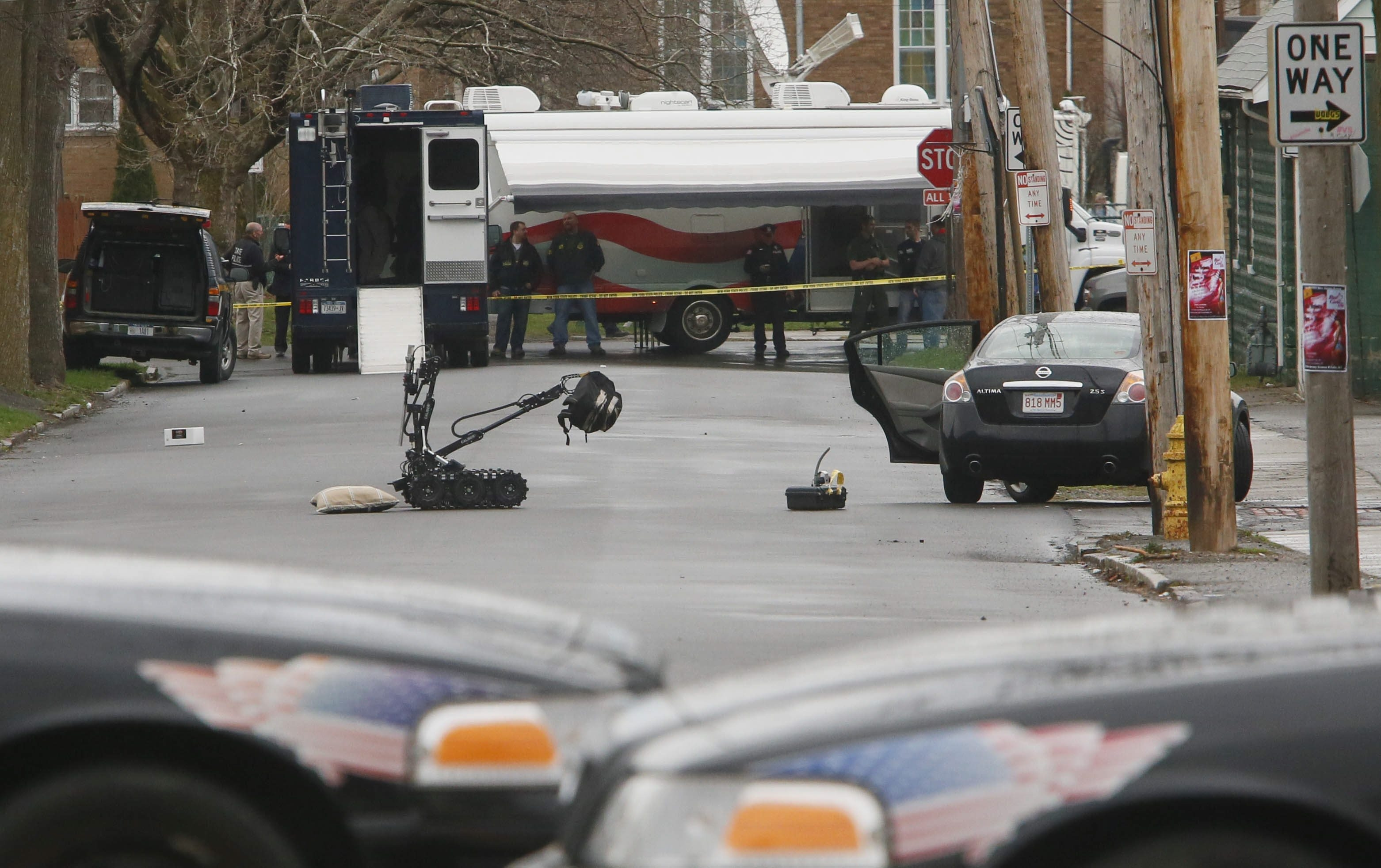 Law enforcement surrounds the block of Elmwood Avenue in Niagara Falls where a state police bomb squad is searching a vehicle.