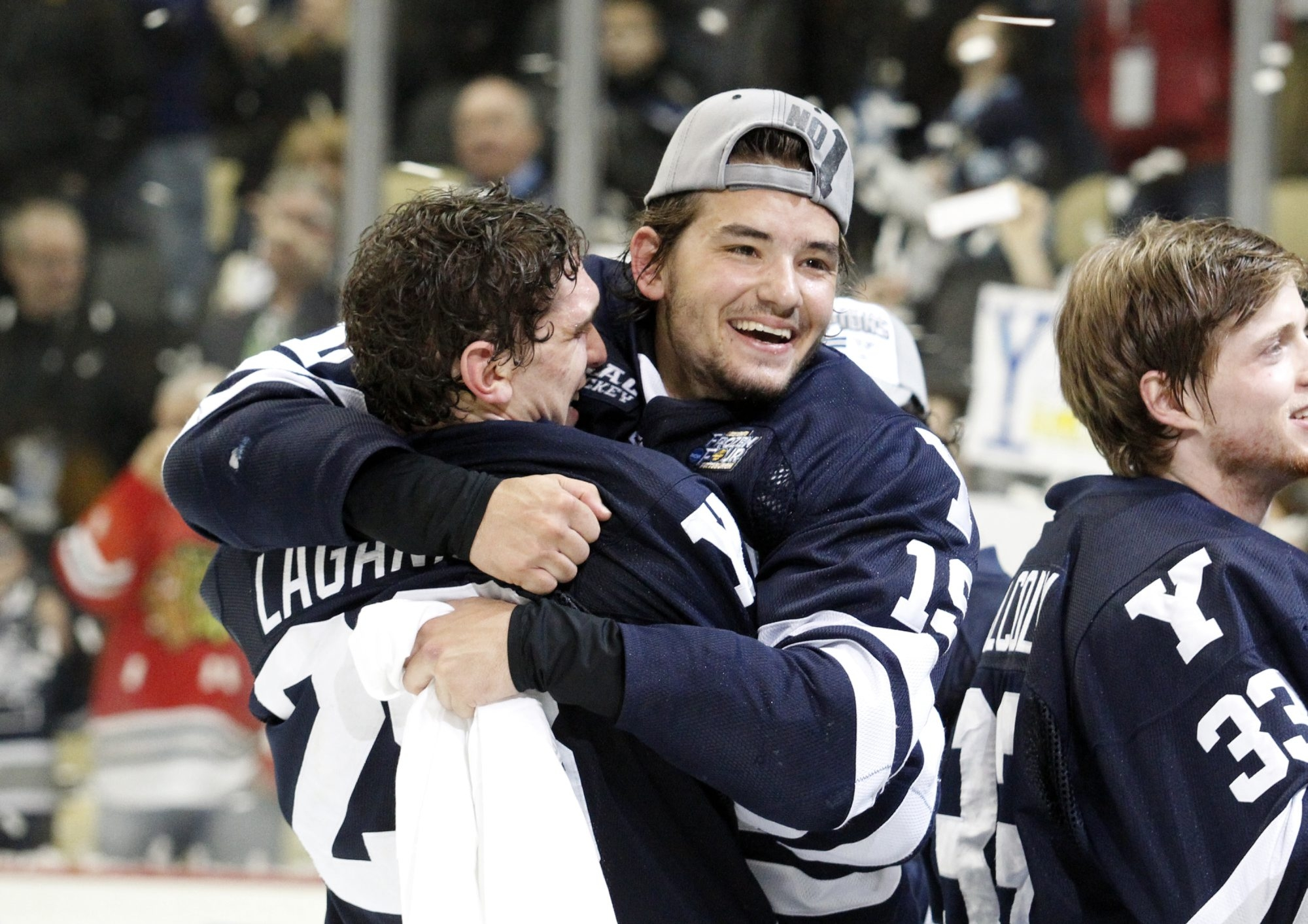 Anthony Day (19) celebrates Yale's shutout victory over Quinnipiac in the NCAA championship game.