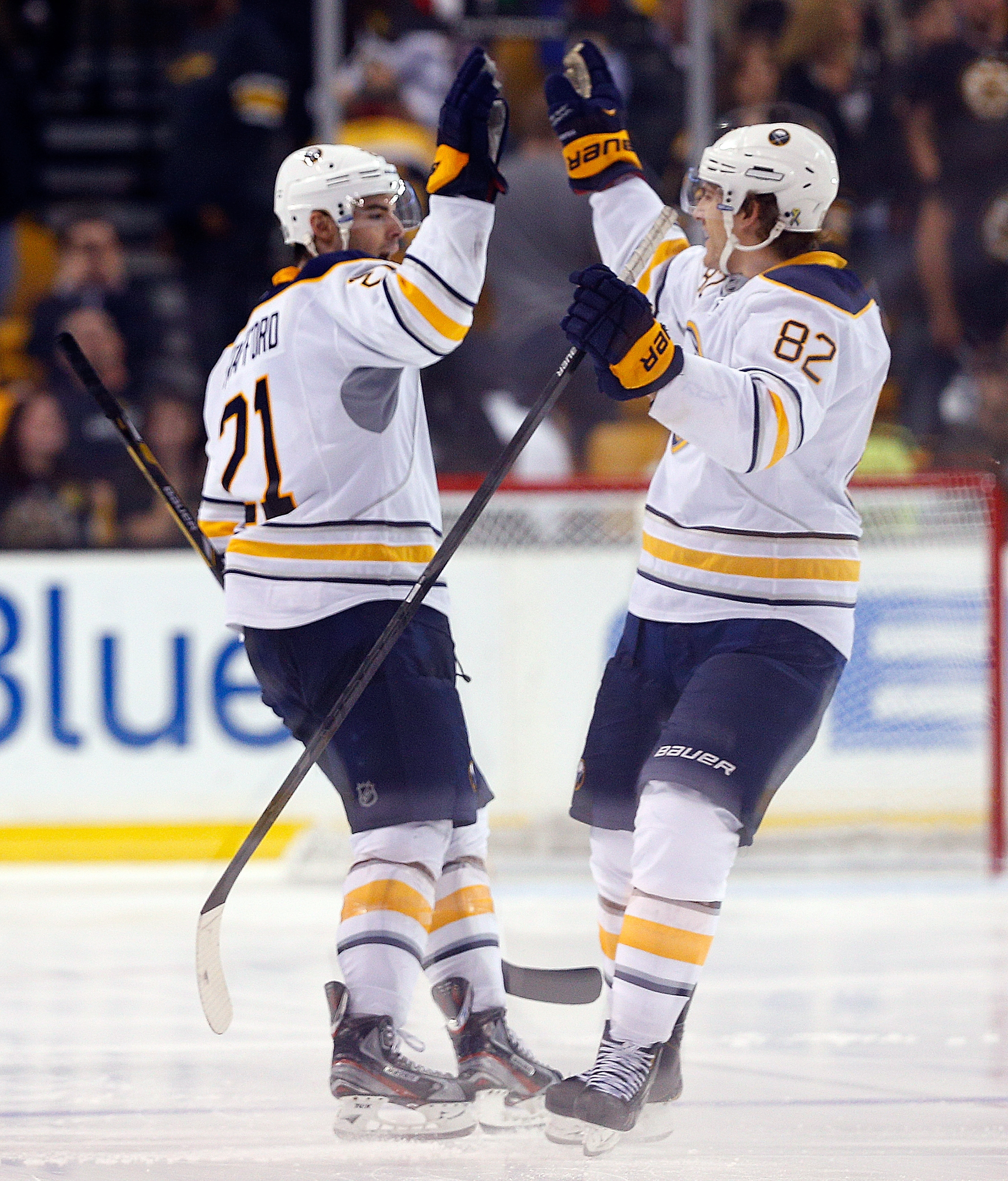 Drew Stafford celebrates with Marcus Foligno after beating Anton Khudobin for the only goal of the shootout.