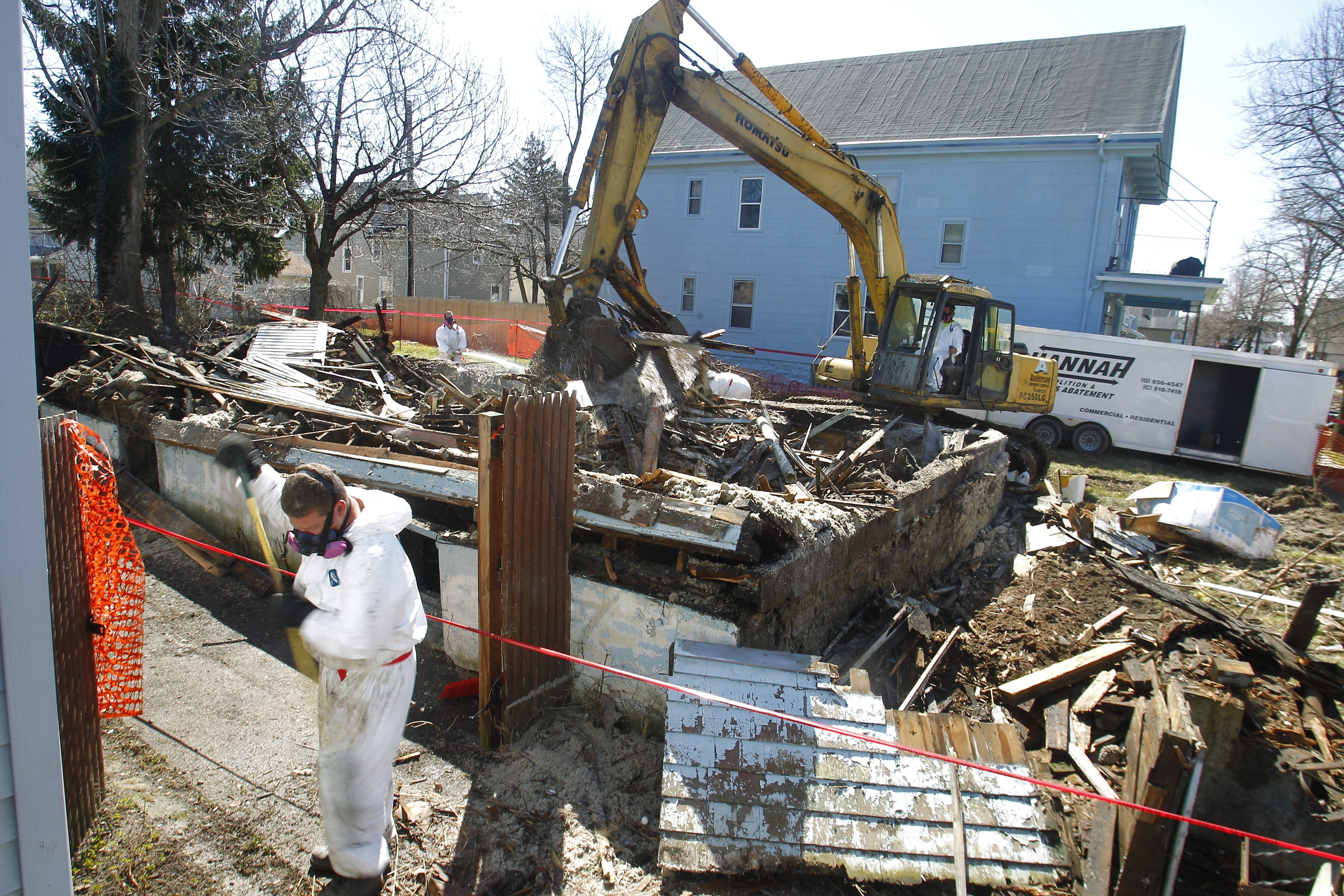 A crew from Hannah Demolition takes down a home on Waverly Street in Buffalo on Wednesday as part of the city's Clean Sweep program.