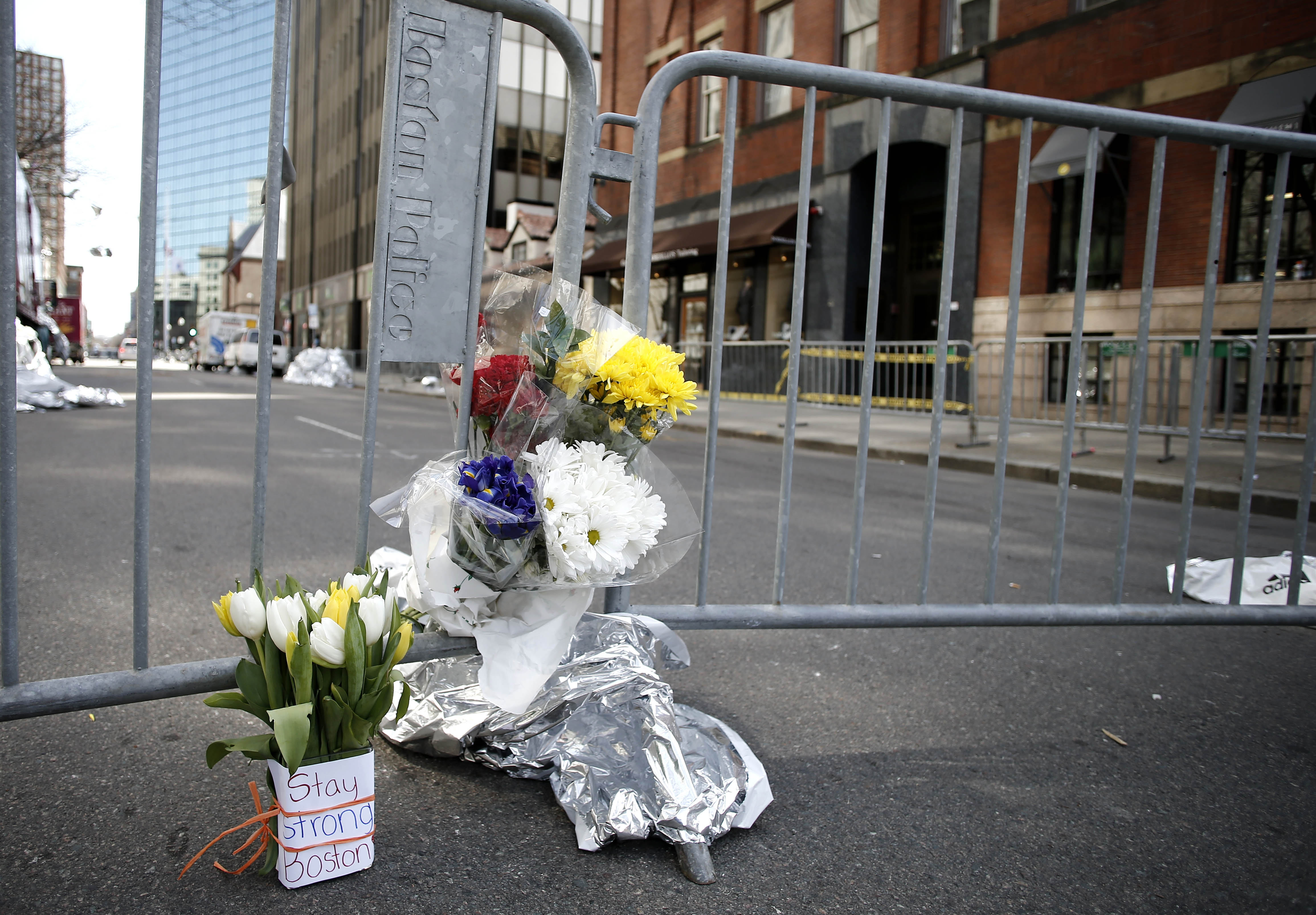 """Flowers at a makeshift memorial near the finish line of the Boston Marathon carry the message """"Stay Strong Boston."""""""