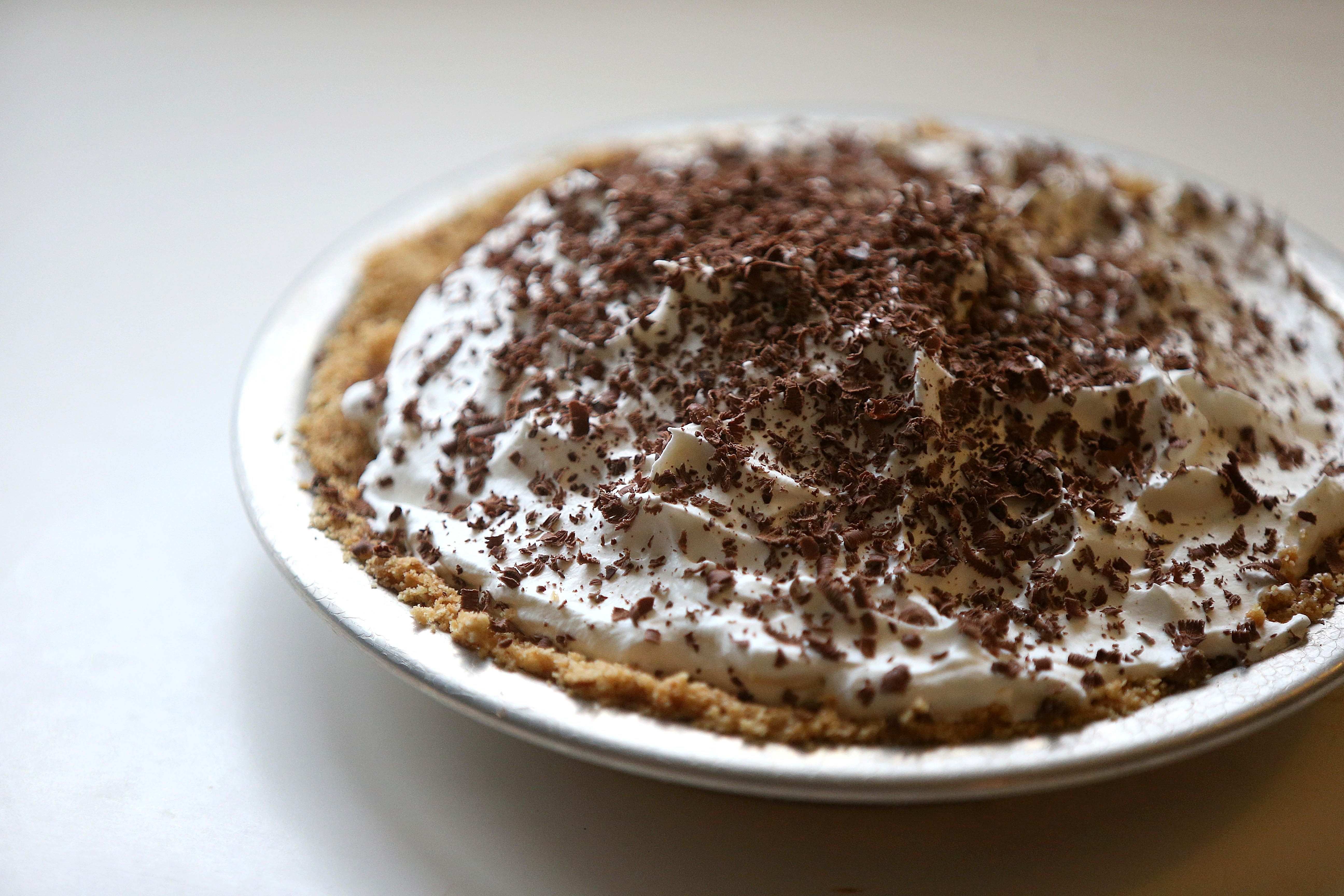 East Banoffee Pie: biscuits, butter, caramel, whipped cream, chocolate.