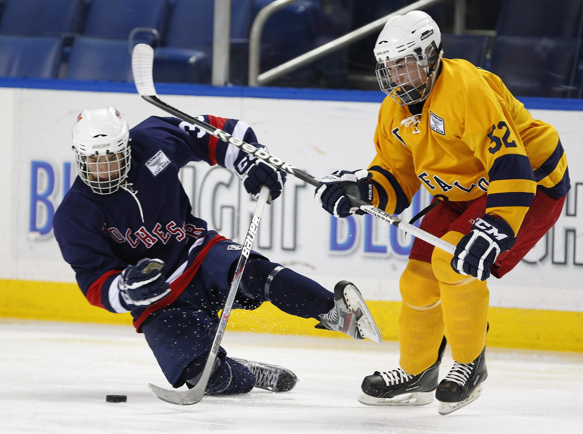 Buffalo senior Ty Gallagher (52) from Grand Island checks Rochester senior Anthony Crawford during the Scotty Bowman Showcase at the First Niagara Center.