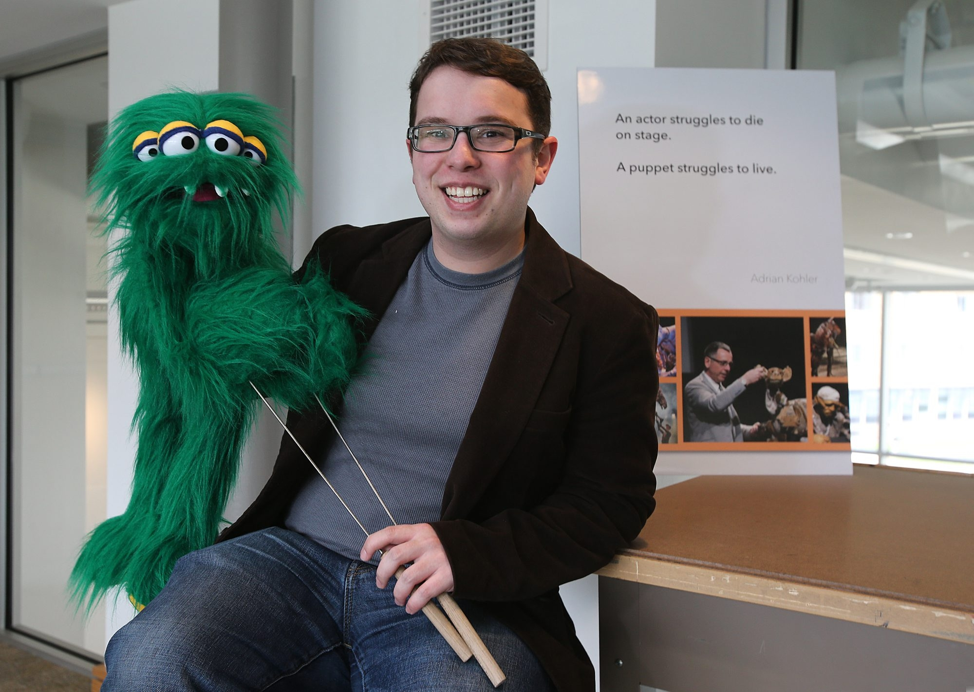 """Daemen College student Cameron Garrity holds """"Scrap,"""" a puppet he created from a scrap of fabric given to him by his mentor, the late local puppeteer Jim Menke."""