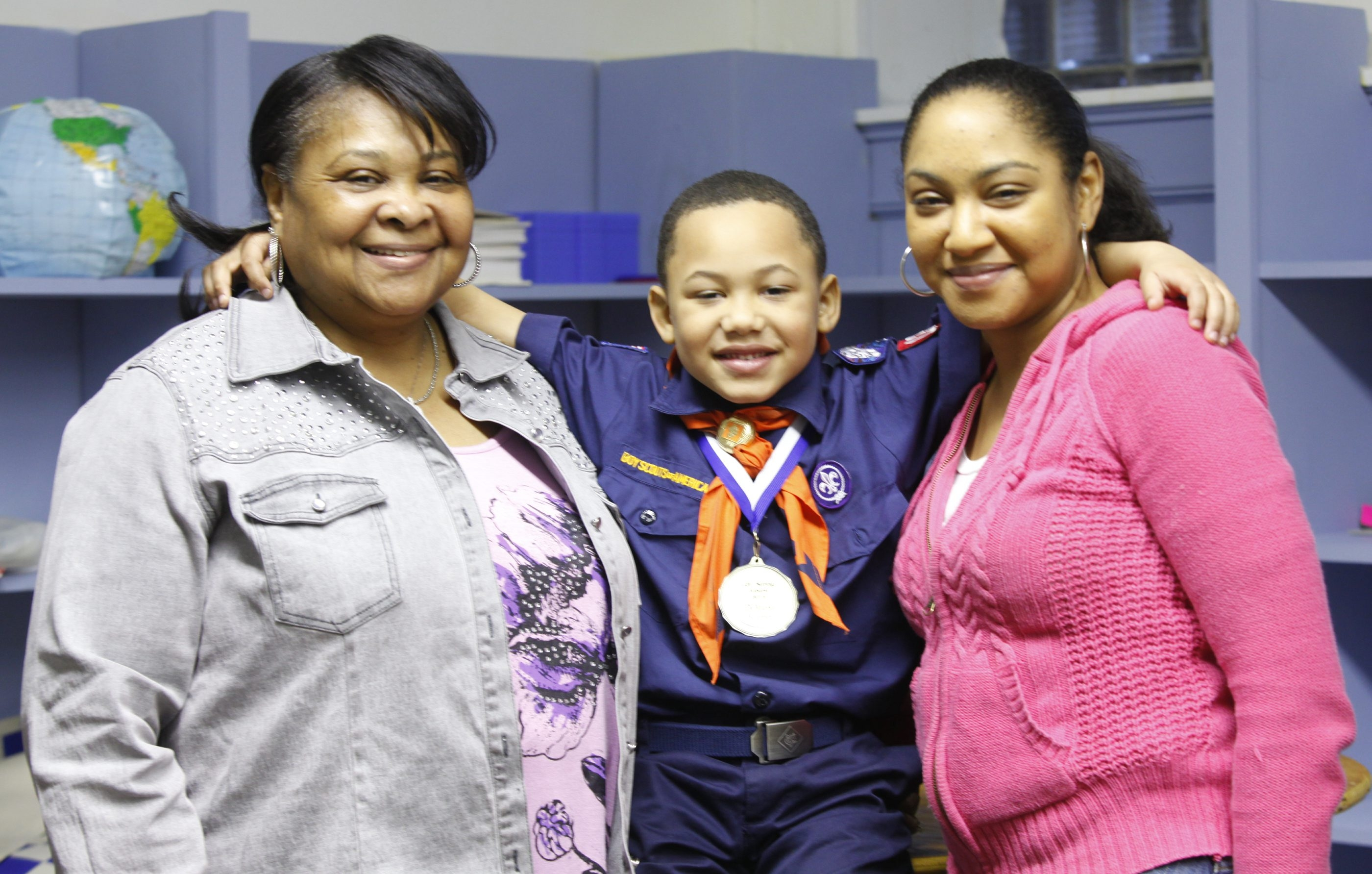 Cub Scout DeMaris Scarver, center, shown with his mother, Dinesha Scarver, right, and his grandmother Diane Scarver, was presented with his troop's 2013 Lifesaving Award recently.