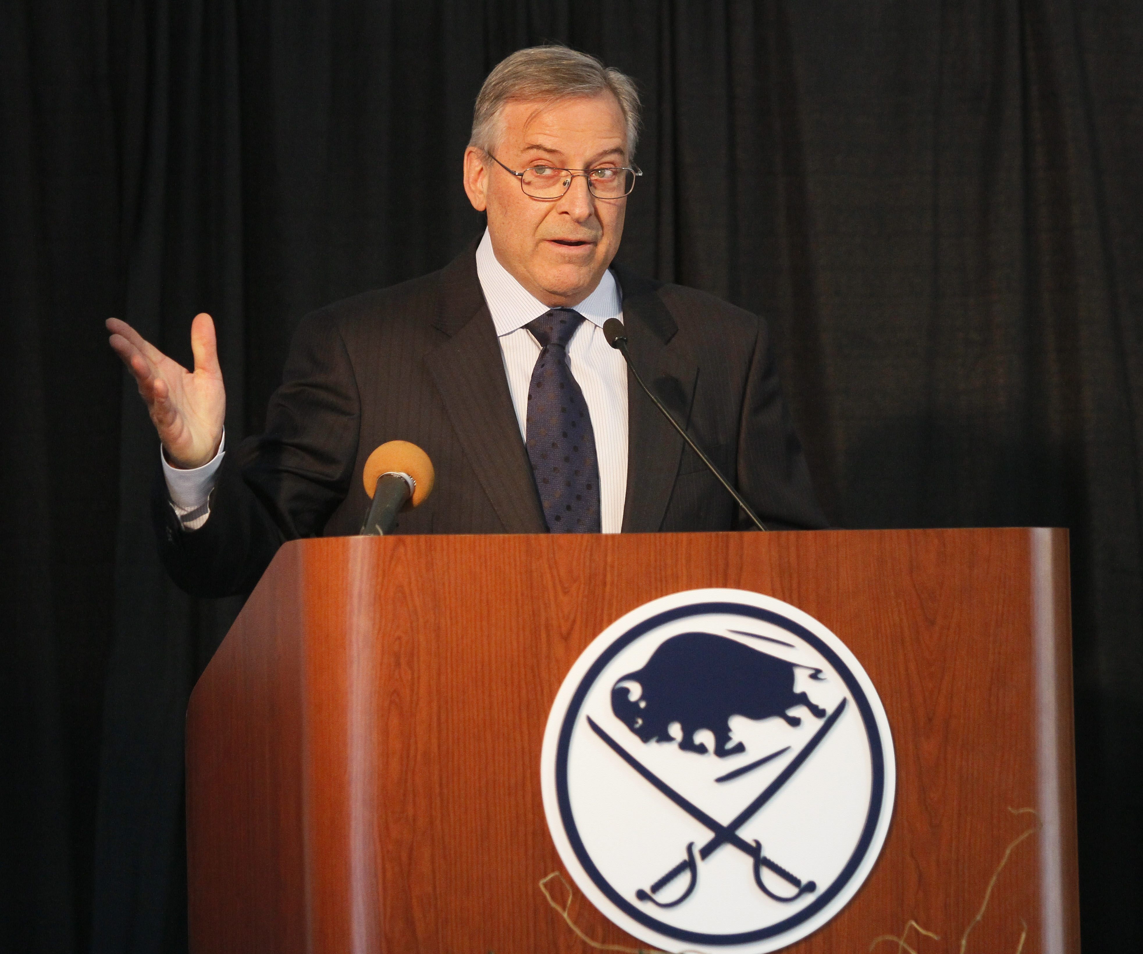 Sabres owner Terry Pegula speaks Saturday during a ceremonial groundbreaking for the HarborCenter complex.