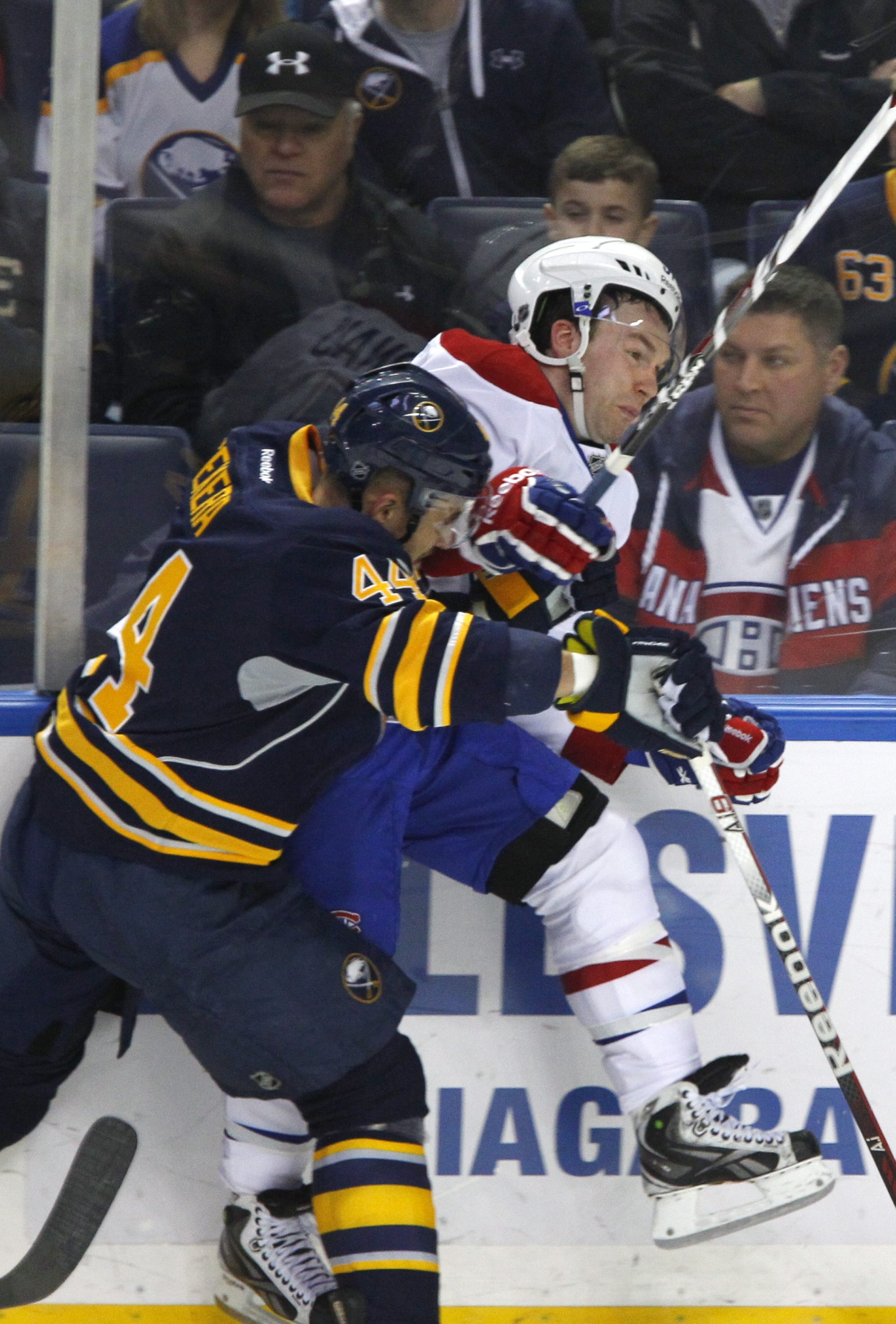 Buffalo defenseman Andrej Sekera checks Montreal forward David Desharnais in the first period of a 5-1 rout by the Habs.