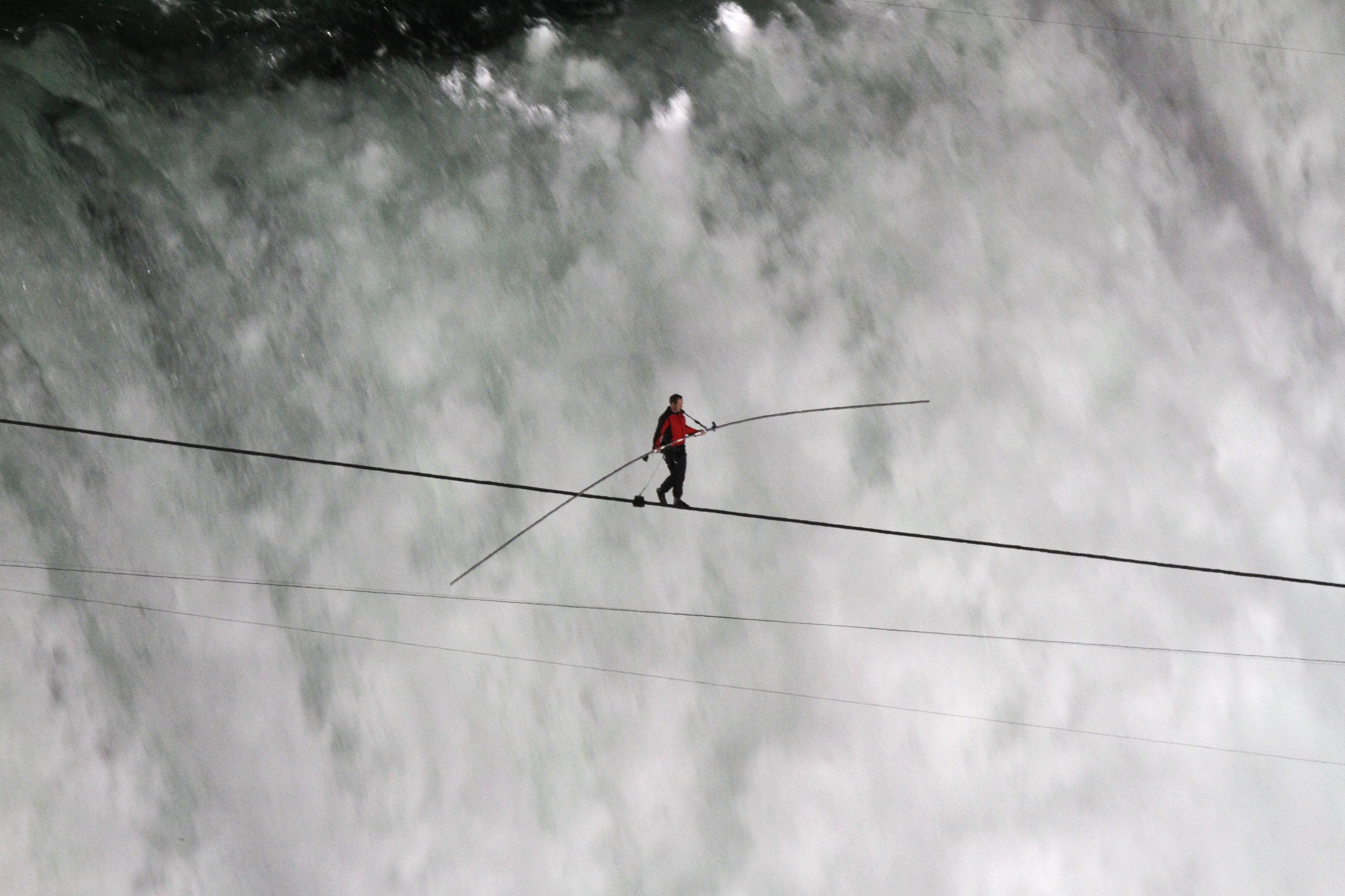 News Chief Photographer Derek Gee won best photo in the news photography category for news photo of Nick Wallenda's historic tight-rope walk over Niagara Falls.