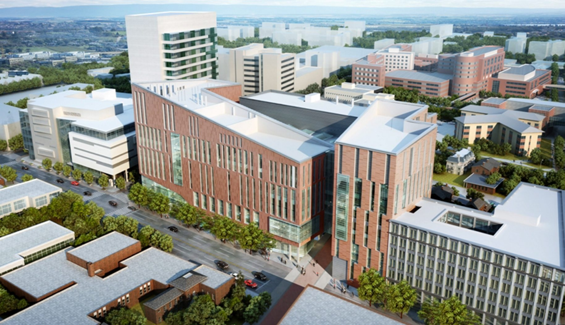 The design for UB's new Medical School at Main and High streets, unveiled Wednesday, includes two L-shaped buildings joined by a six-story atrium, which is naturally illuminated by skylights and glass walls.