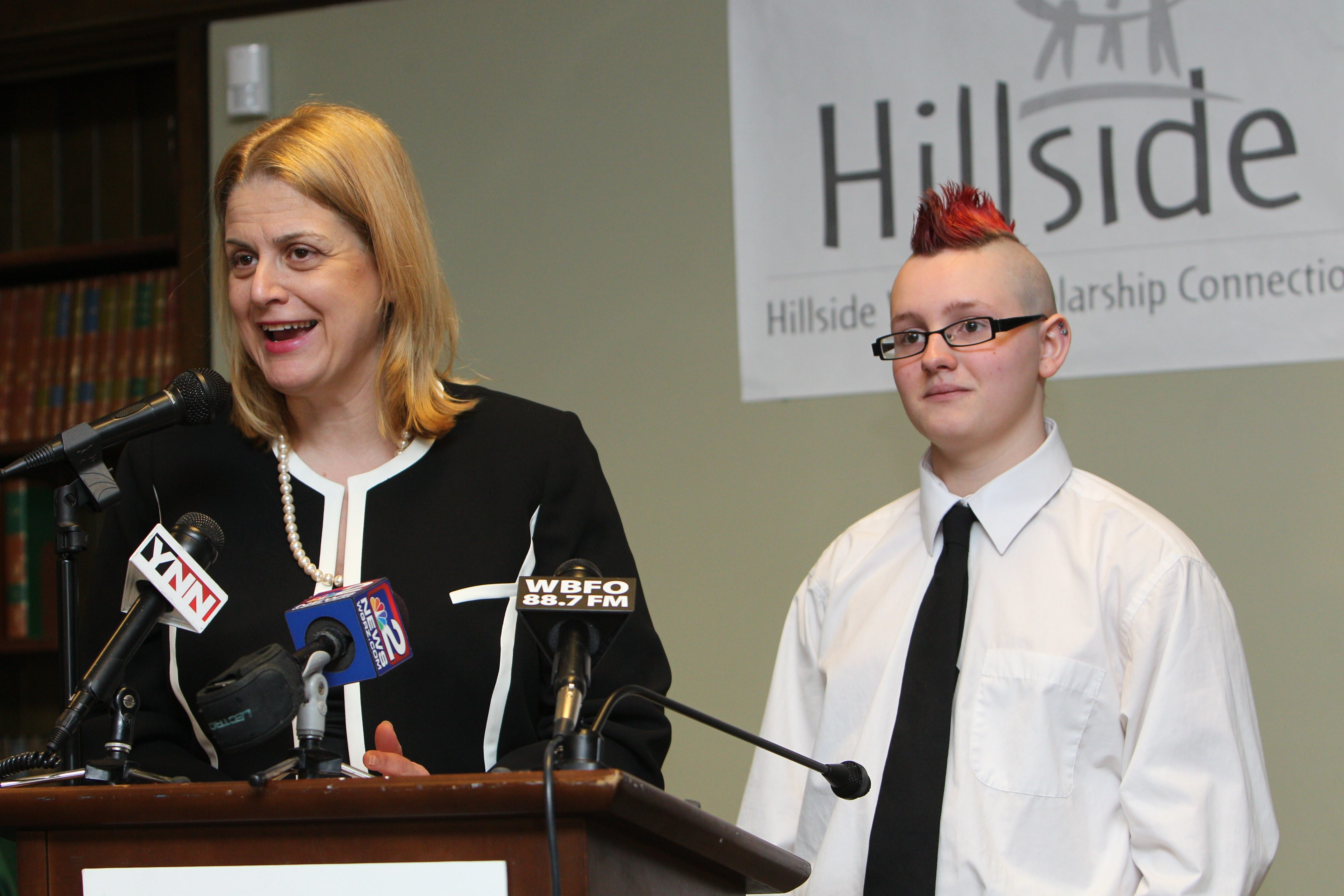 South Park Principal Terri Schuta introduces Tyler Krusko, a student taking part in the Hillside Work-Scholarship dropout prevention program started by Wegmans, at a media event Wednesday.
