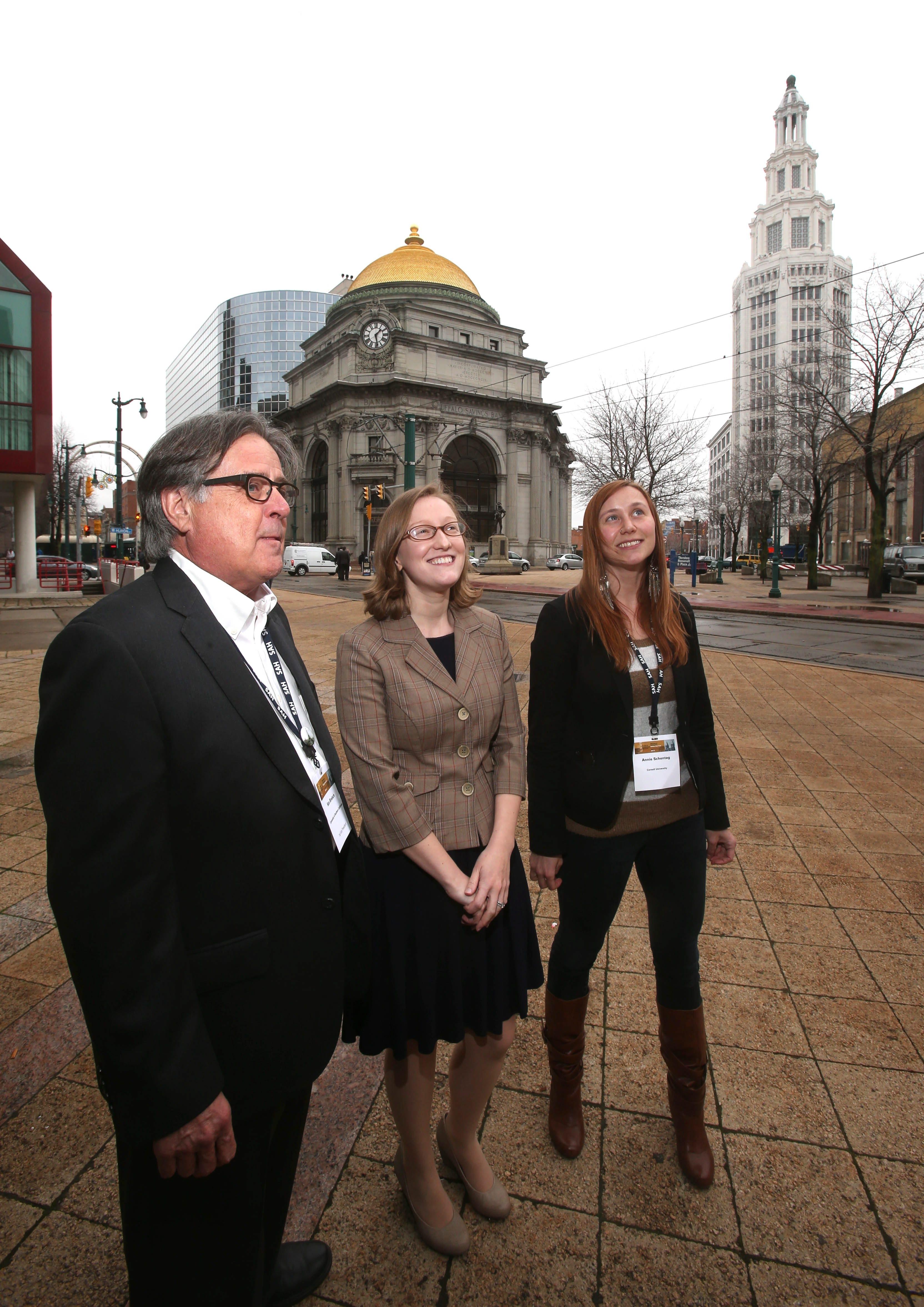 Architectural historians Kenneth A. Breisch, left, Catherine Boland Erkkila, center, and Annie Schentag tour sites on Buffalo's Main Street on Wednesday.