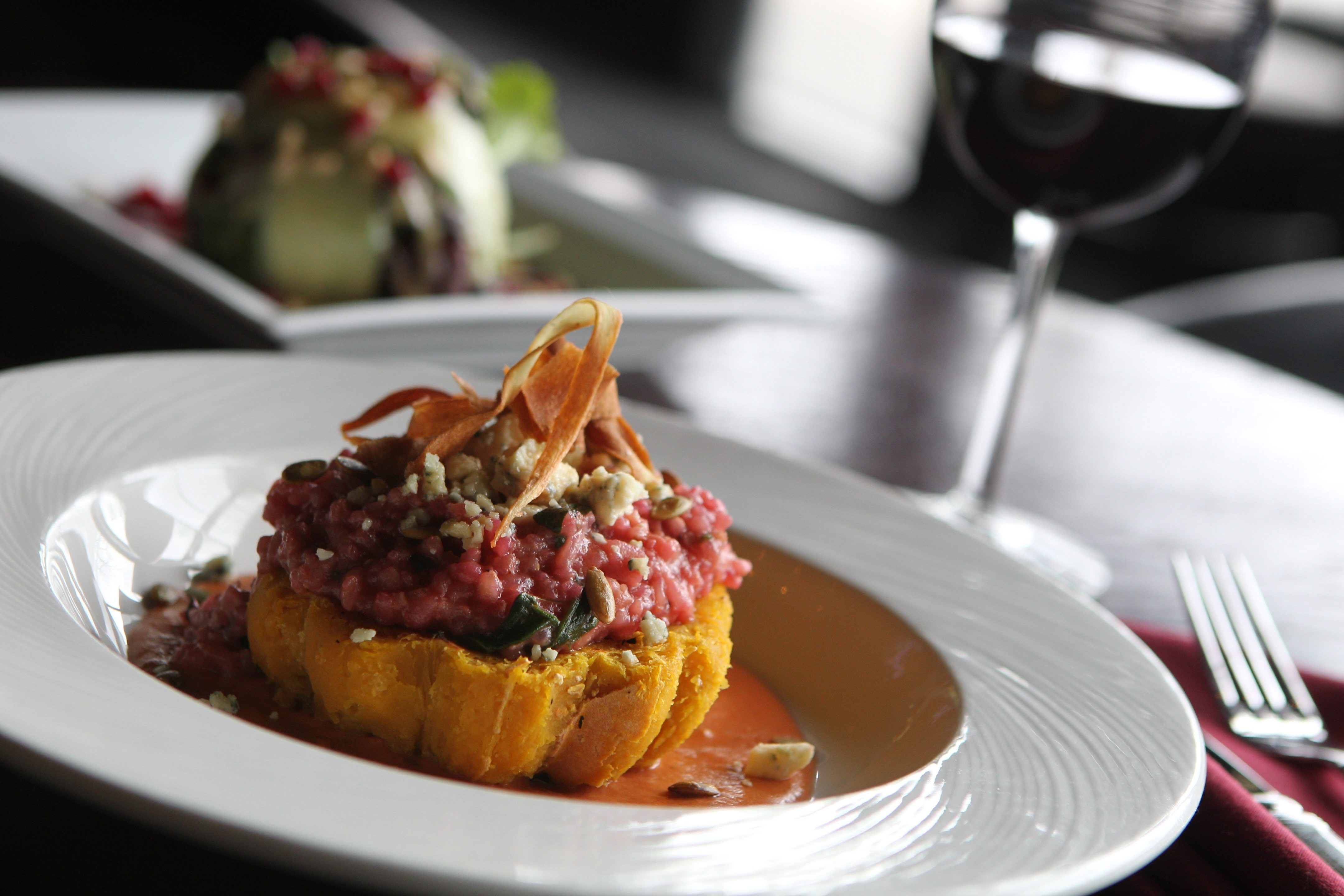 This is the acorn squash risotto with heirloom pink spinach risotto, smoked blue cheese, toasted pumpkin seeds and crispy parsnips at Perfetto. (Sharon Cantillon/Buffalo News)