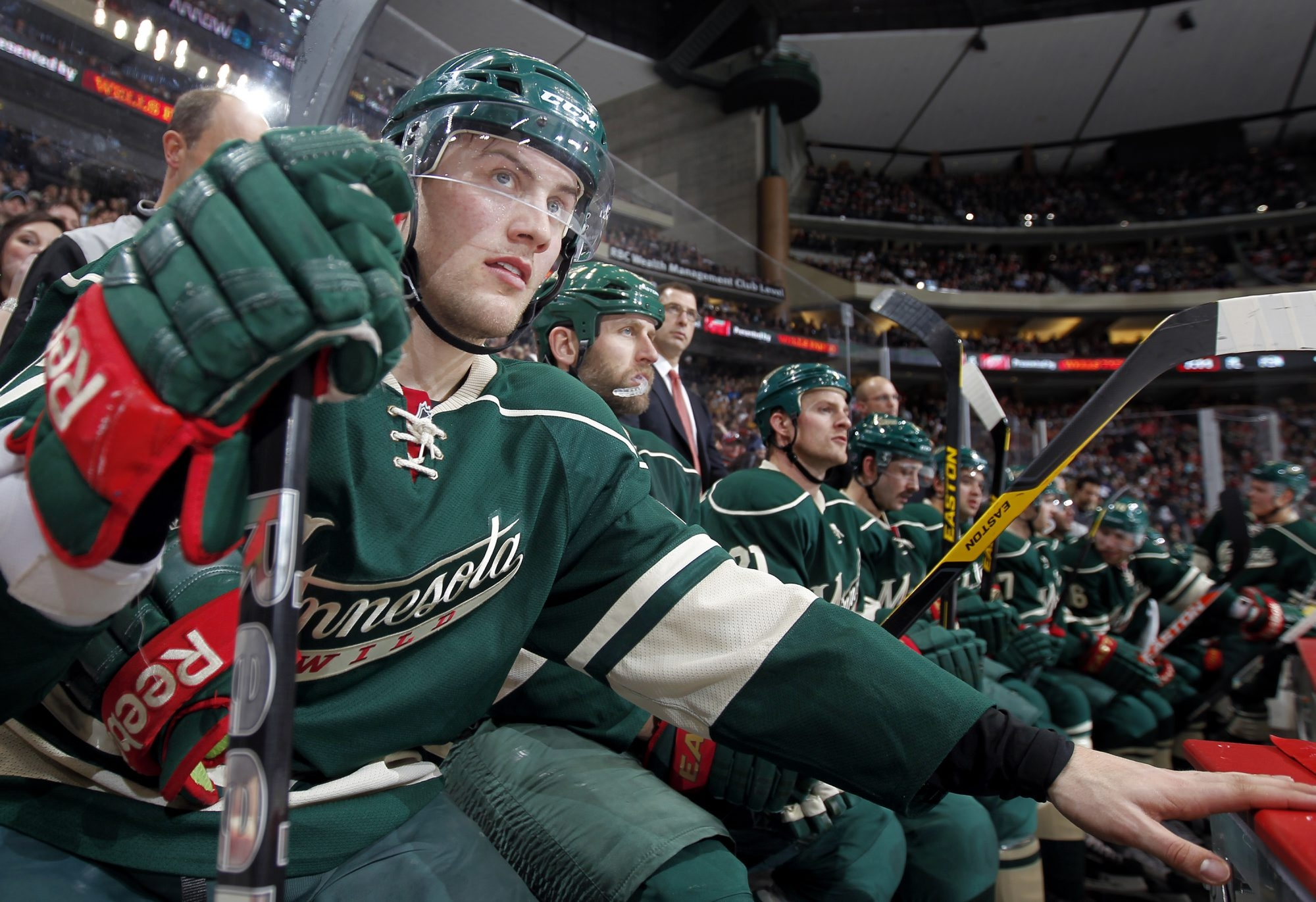 Minnesota Wild rookie Johan Larsson (47) sits on the bench in the third period against the Detroit Red Wings at the Xcel Energy Center in St. Paul, Minnesota, Sunday, February 17, 2013. The Wild defeated the Red Wings, 3-2. (Carlos Gonzalez/Minneapolis Star Tribune/MCT) ORG XMIT: 1135059 ORG XMIT: MIN1302172045293946