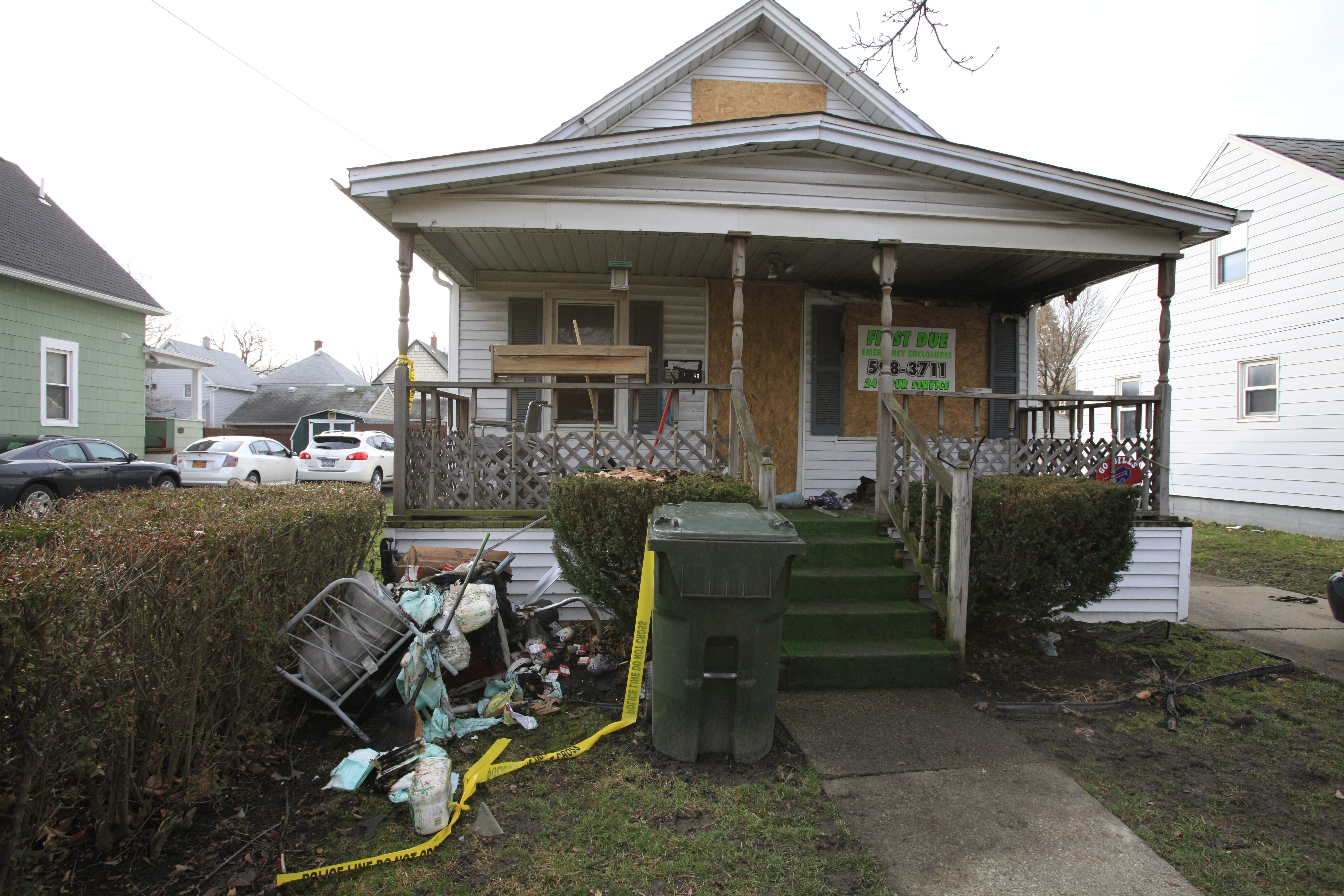 The scene at 53 Third Avenue in North Tonawanda, where a fire claimed two lives late Monday. (Derek Gee/Buffalo News)