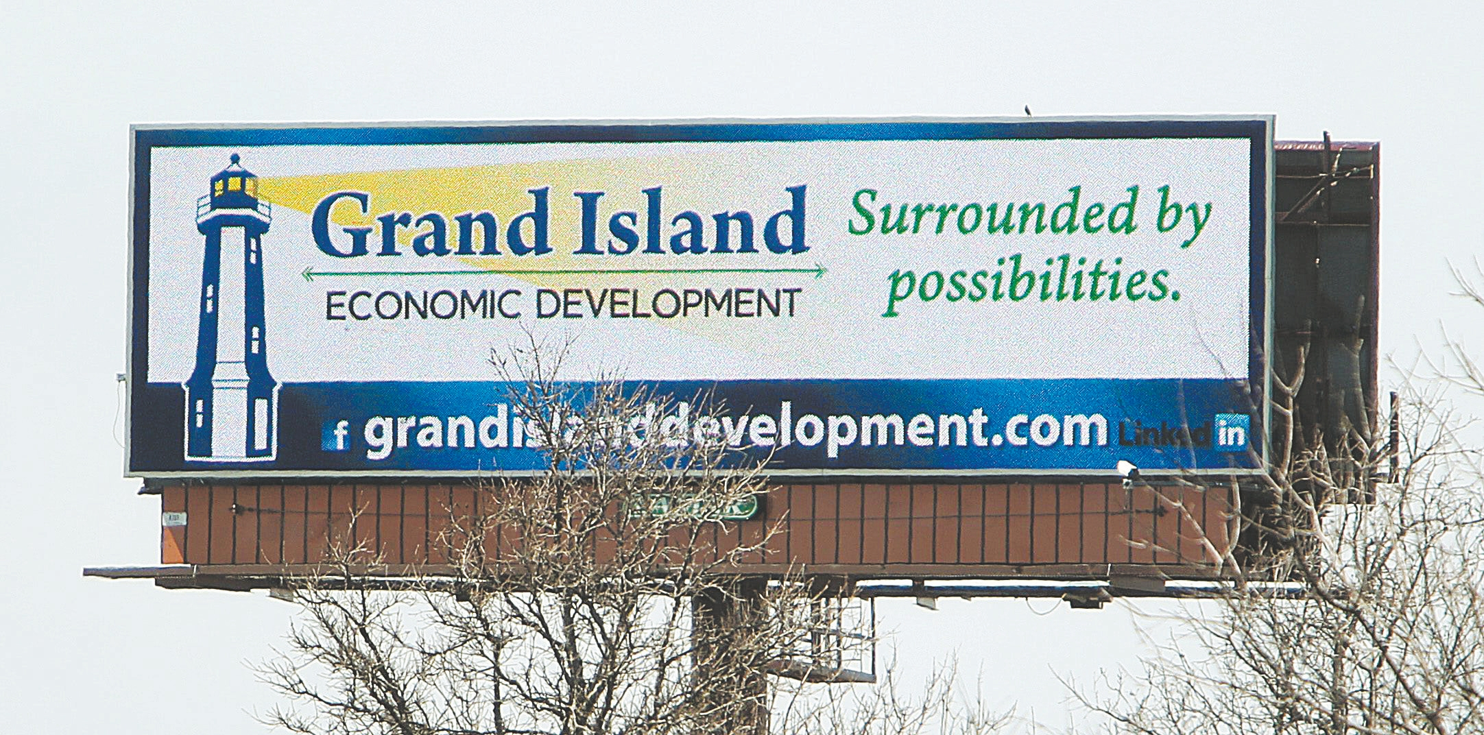 Grand Island's Economic Development Committee has purchased billboard messages aimed at drivers on the I-290 who might be connected to local companies that are looking to expand.