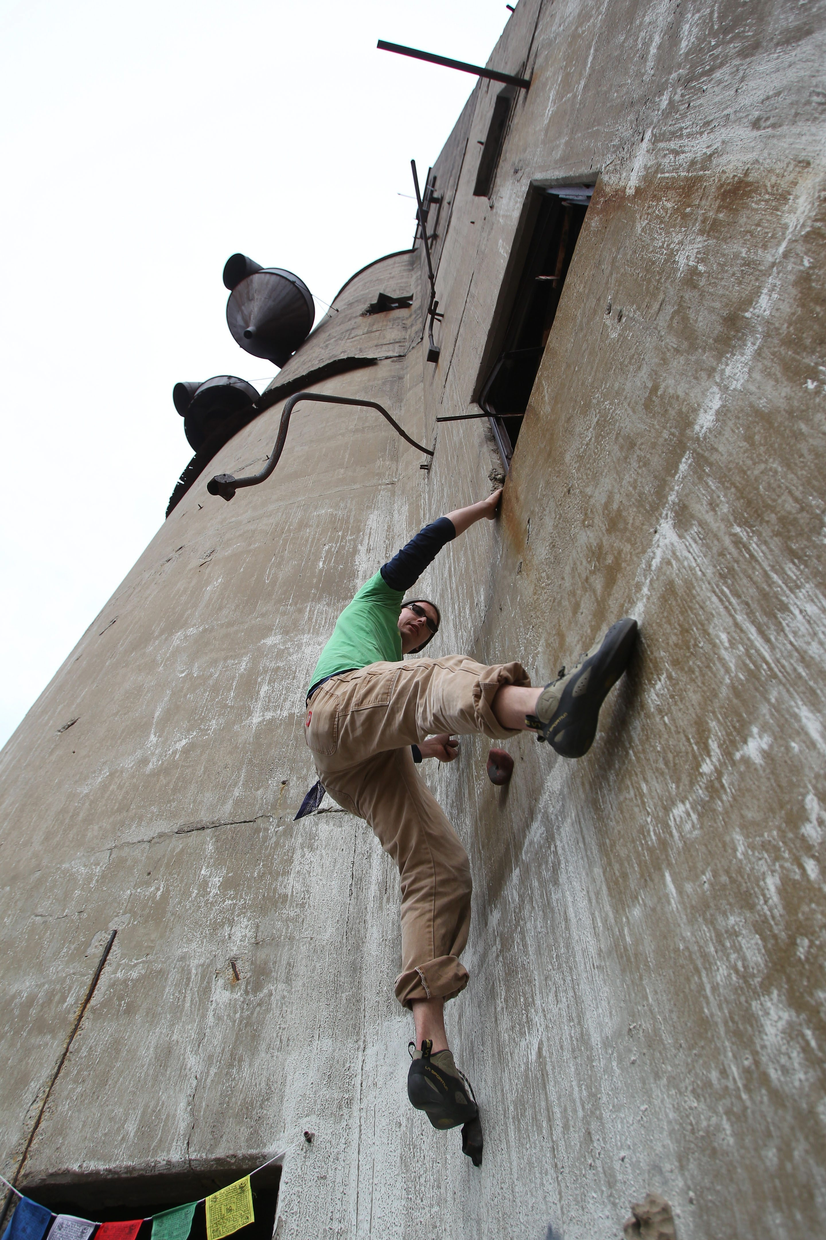Glen Waterman of Forestville showed one way that climbers could use the outside of a former grain mill at Silo City during the 11th annual Boom Days bash at the Childs Street facility Saturday.