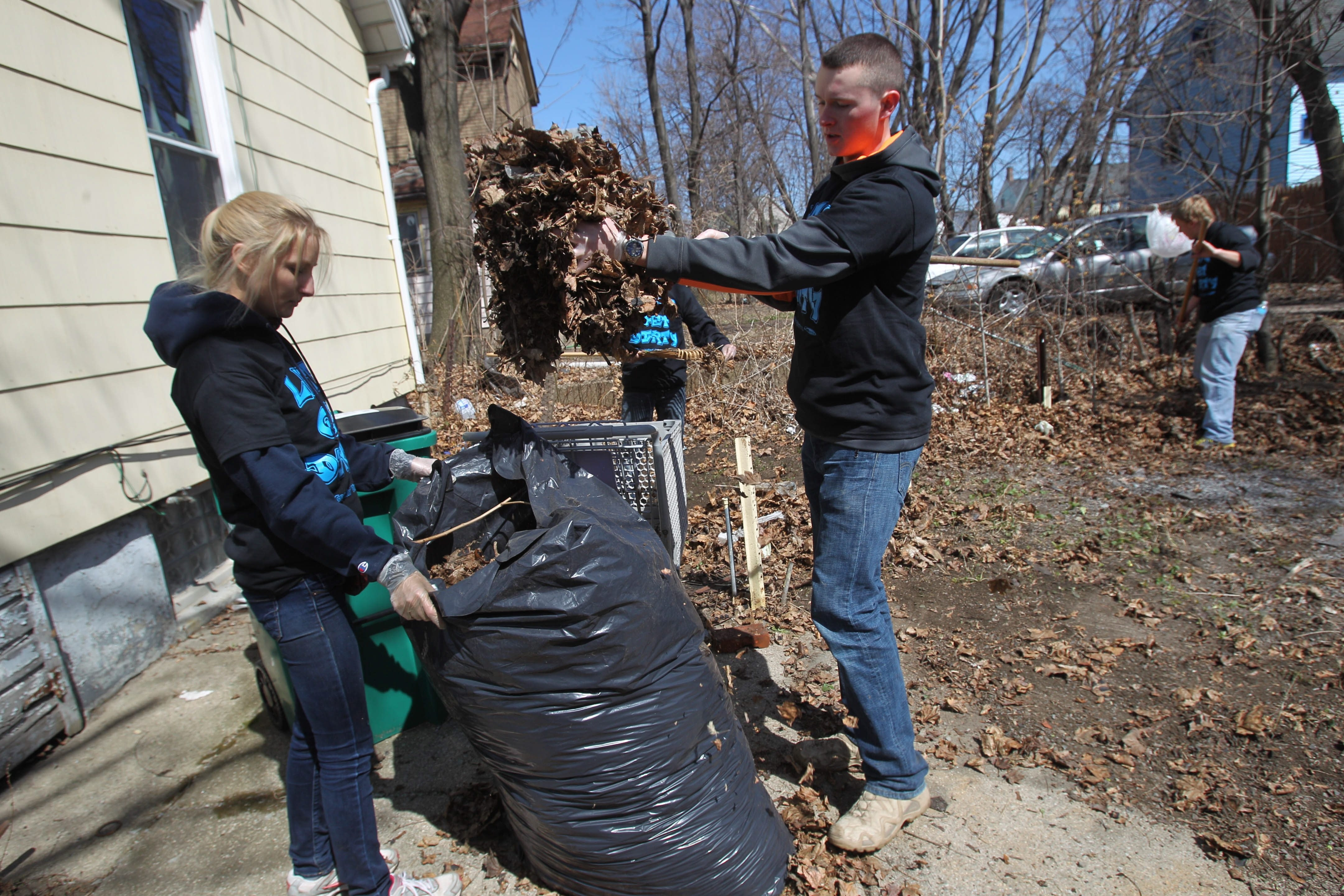 Haleigh Daino and Matt Schultes were among the University at Buffalo students who spent Saturday morning doing cleanup projects in the University and Fruit Belt neighborhoods.