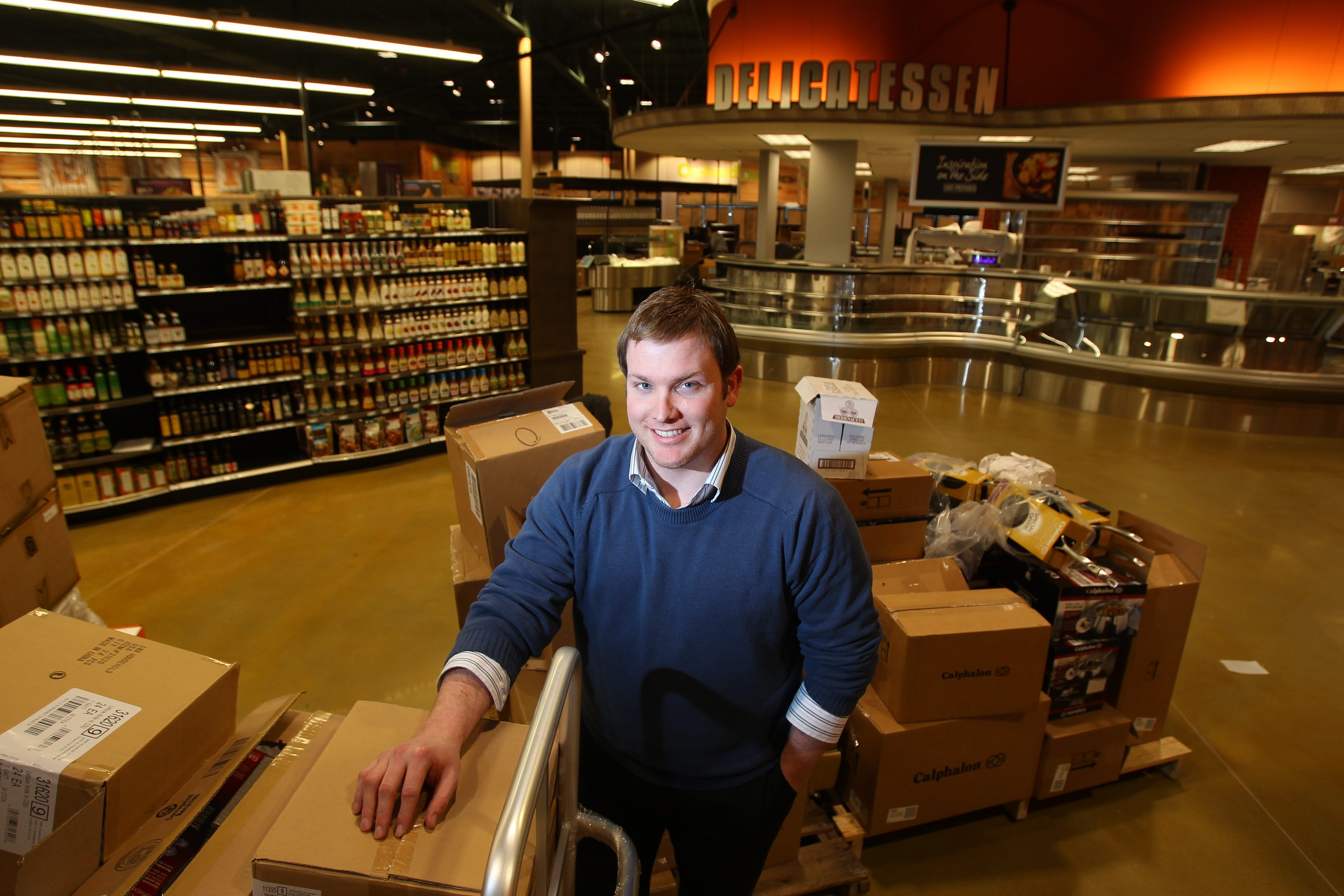 Store director Kevin Donovan was lured back to the region to oversee the new concept store that Tops hopes  will appeal  to 'foodies' and health-conscious  shoppers.