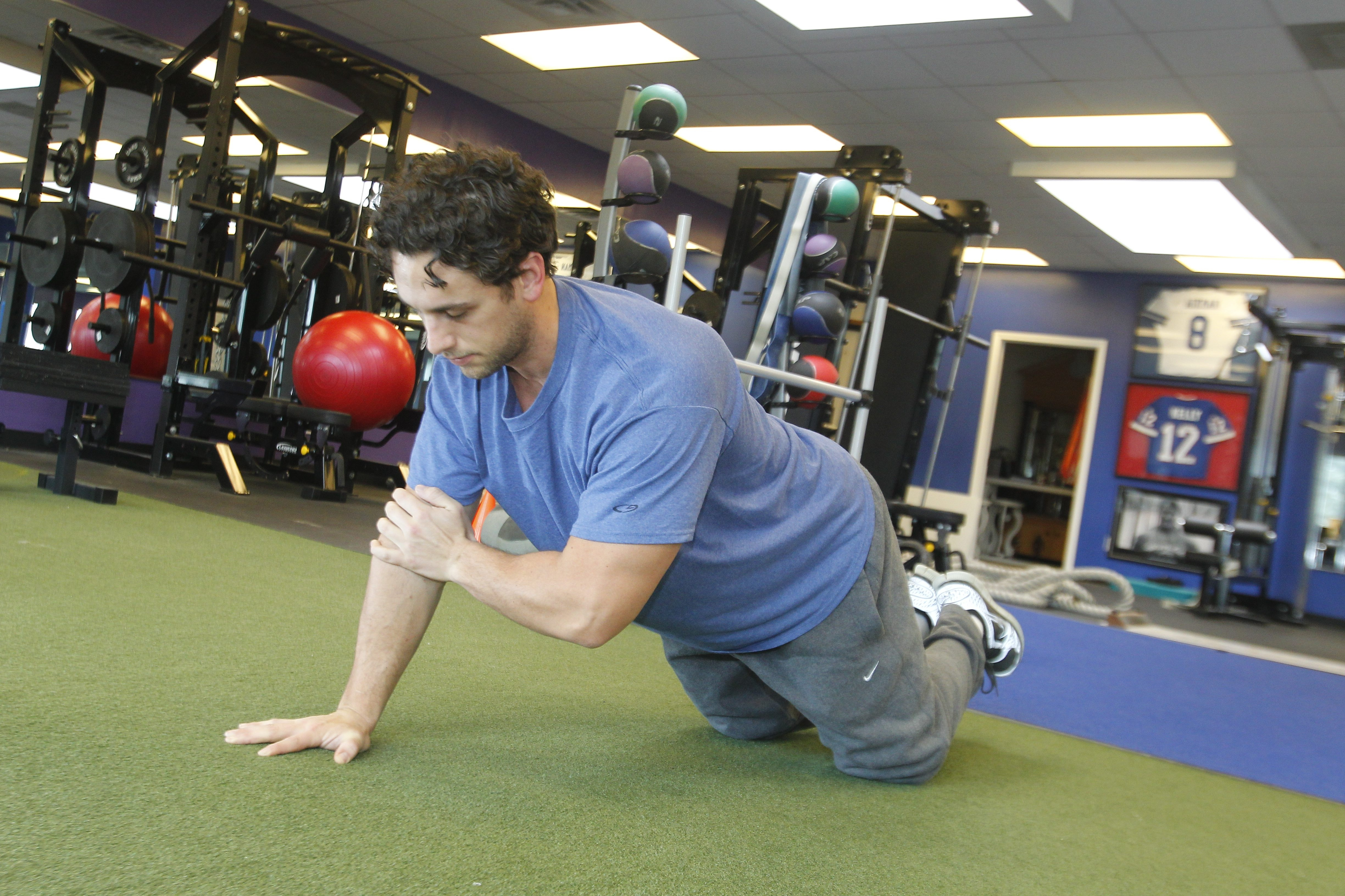 Fred Duncan does a pushup to elbow touch. It's one of many exercises to help prepare for outdoor activity.