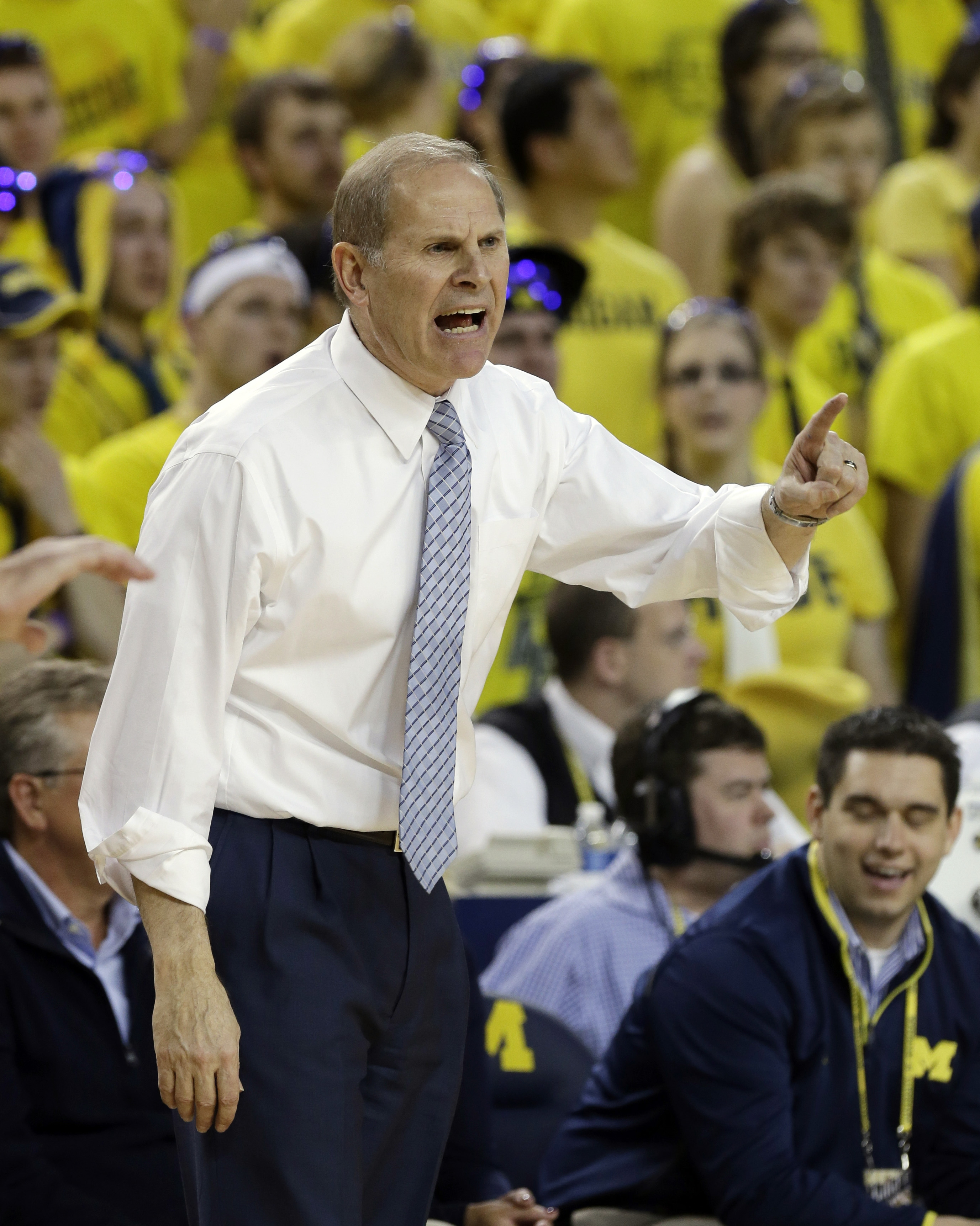 Michigan head coach John Beilein makes a point from the sidelines during a game earlier this year. In the inset photo, that's him on the right at ECC. At left, is Santo DeSain, whose persistence, along with athletic director Ralph Galanti, got Beilein his first coaching job.