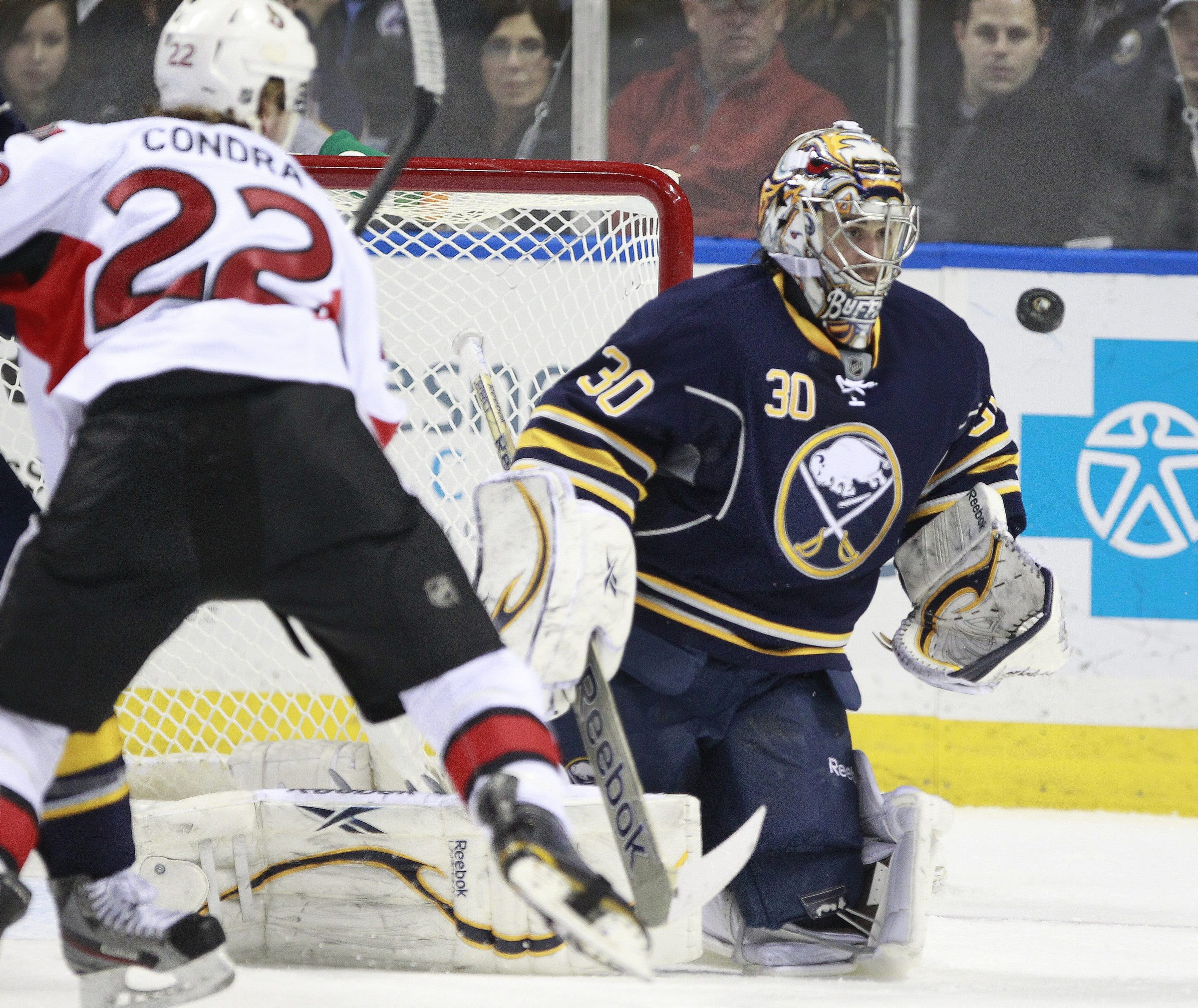 Buffalo Sabres goaltender, Ryan Miller (30), makes a first-period save during action against the Ottawa Senators at the First Niagara Center on Friday, April 5, 2013.  Harry Scull Jr./Buffalo News)