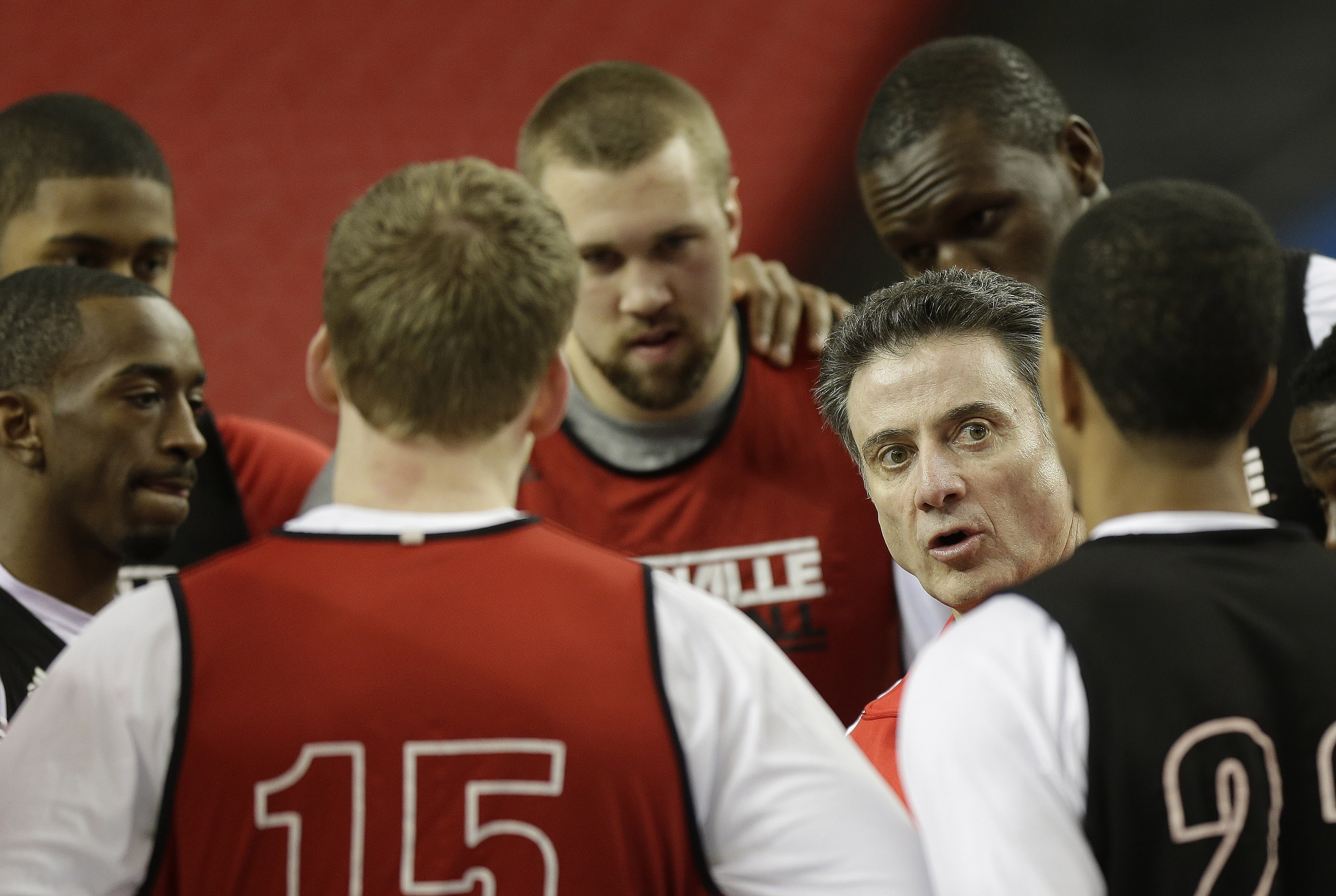 Louisville coach Rick Pitino speaks to his players before practice Friday.